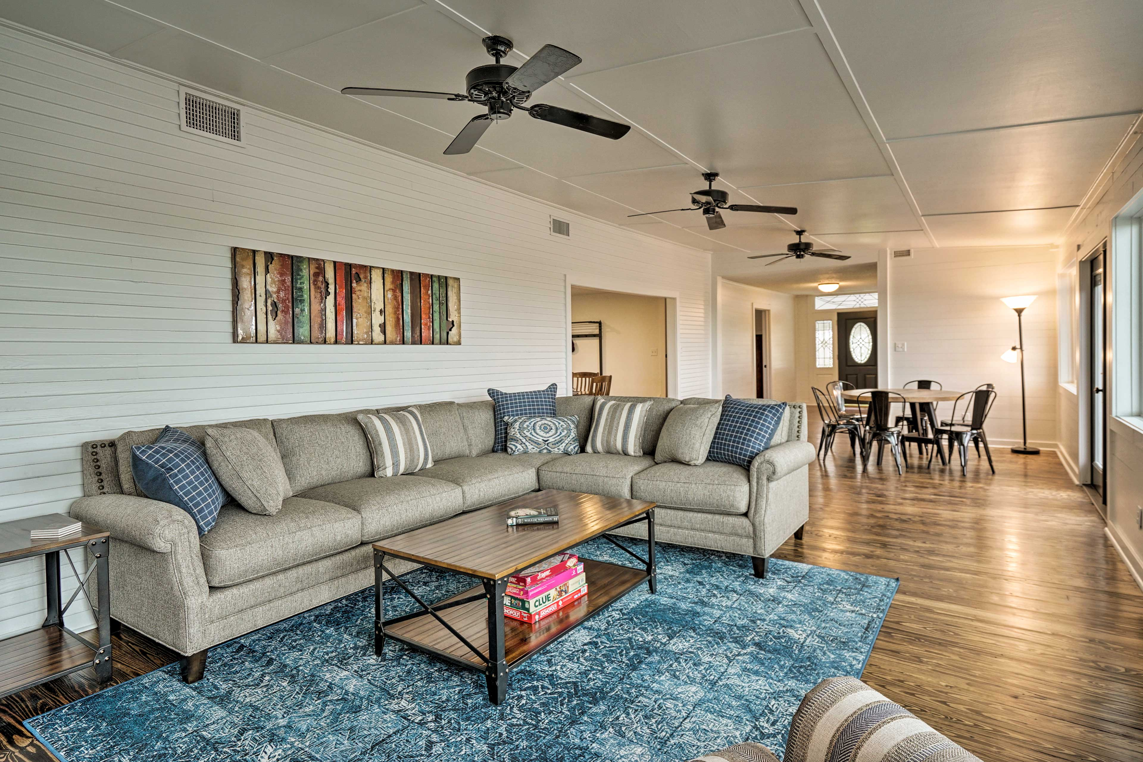 The living room opens into a large dining area.
