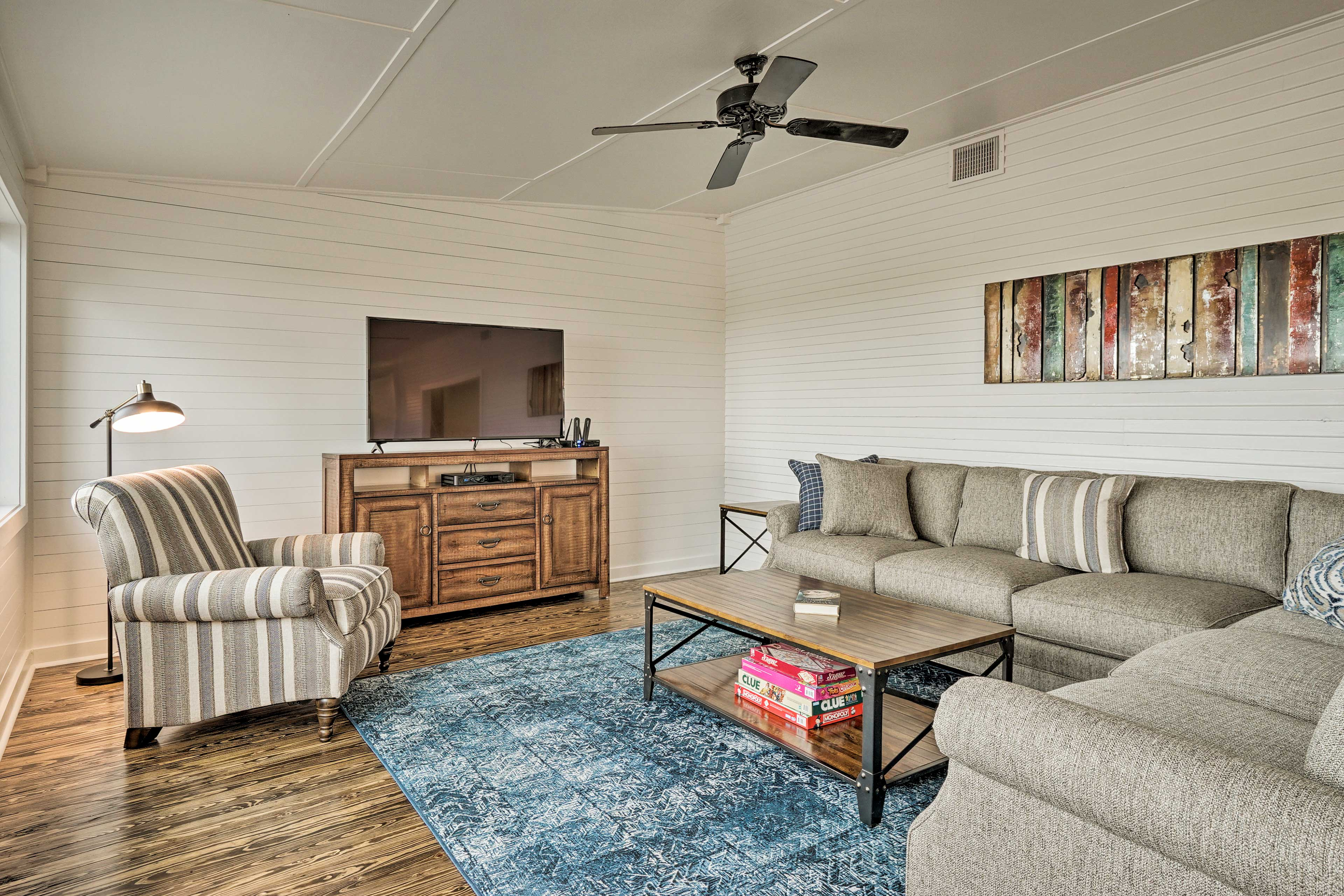 Unwind in front of the flat-screen TV in the living room.