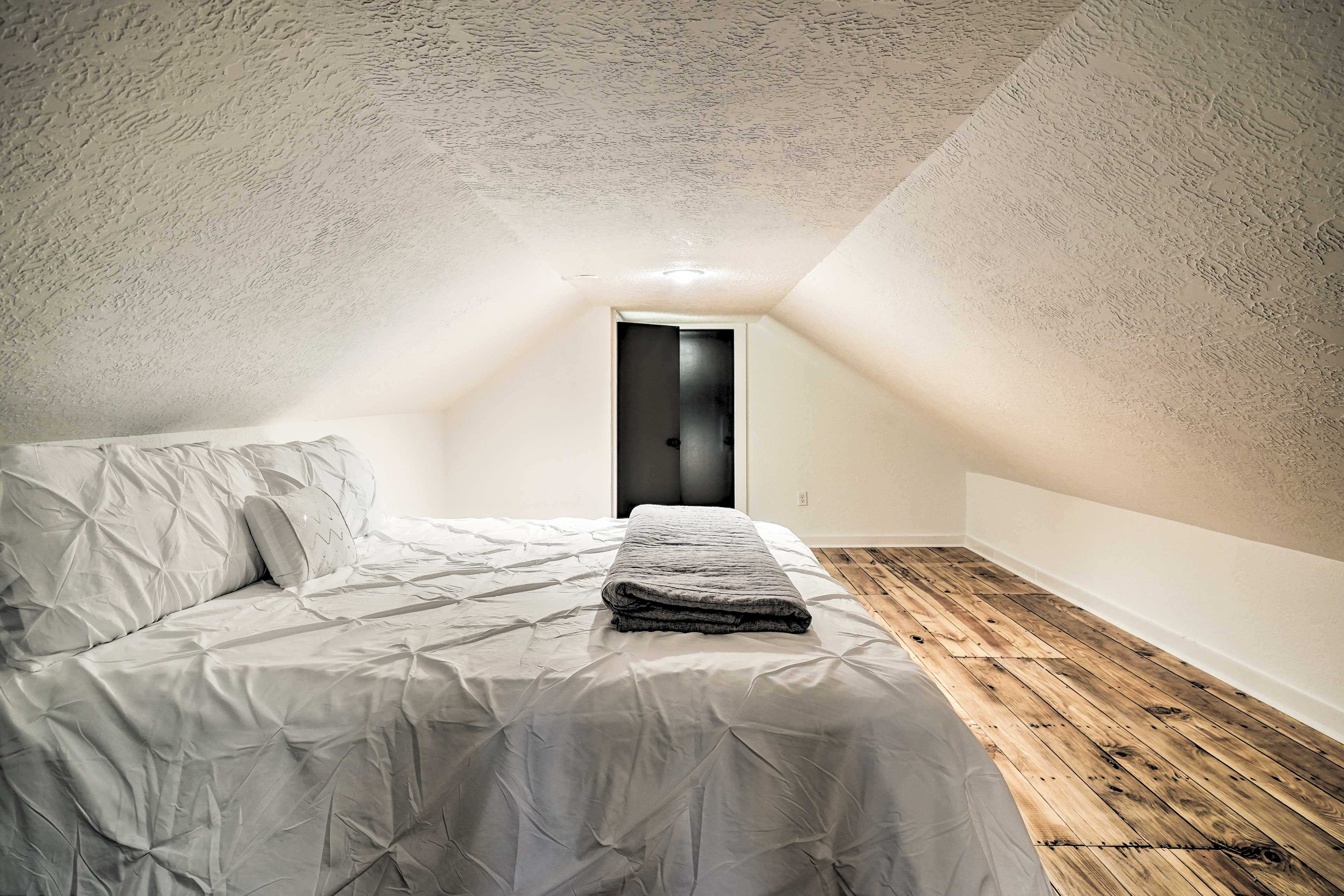 This enclosed space features a queen bed and en-suite bathroom.