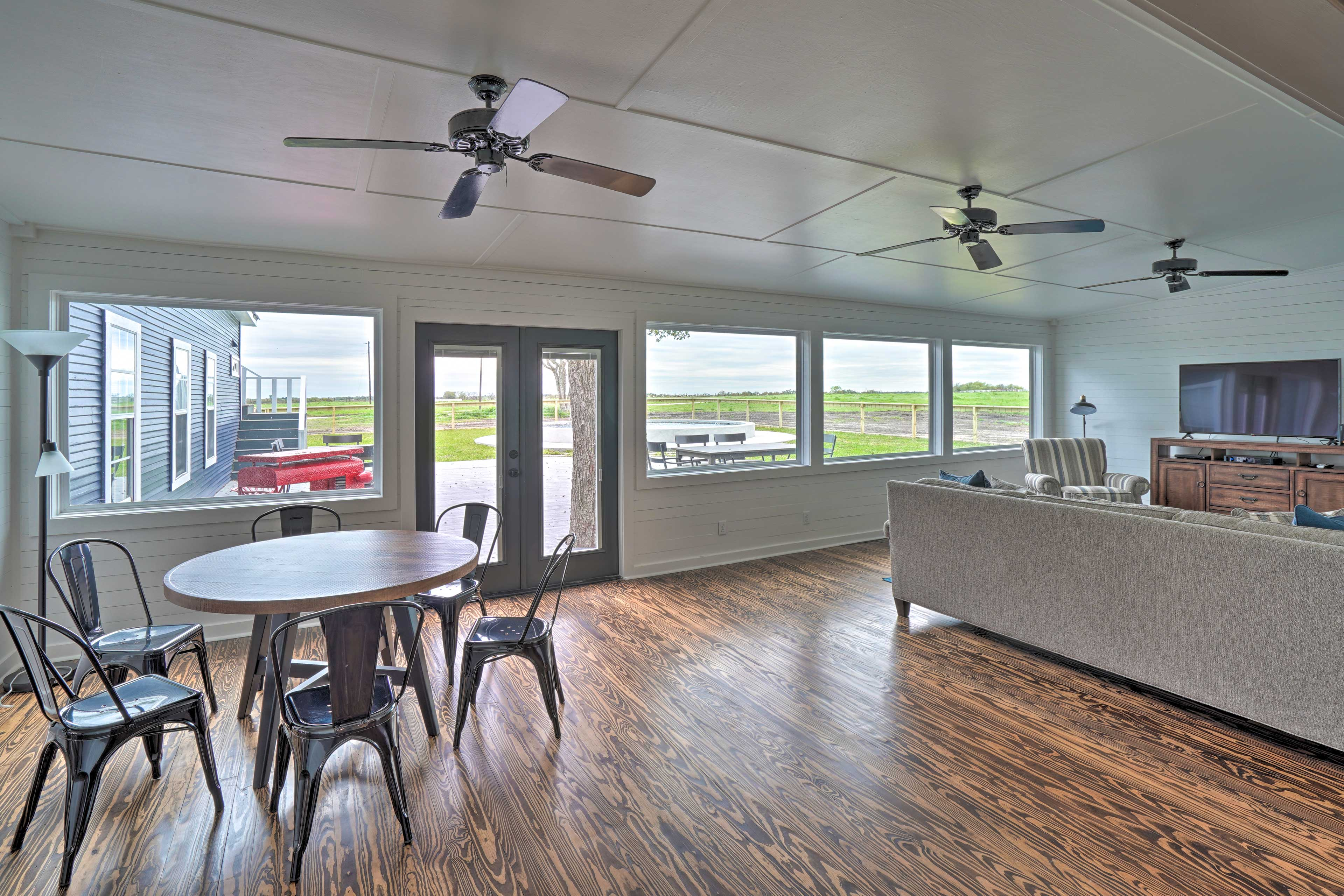 Large picture windows fill the space with natural light.