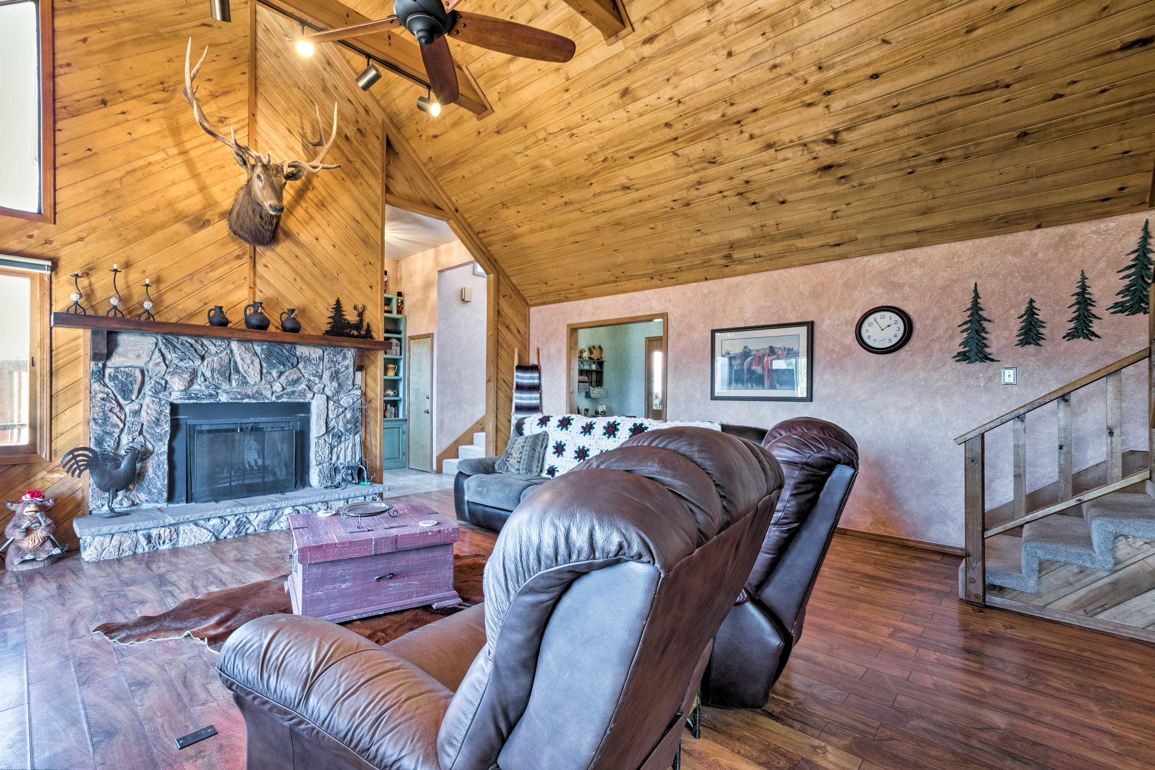 The great room boasts vaulted ceilings and a stone fireplace.