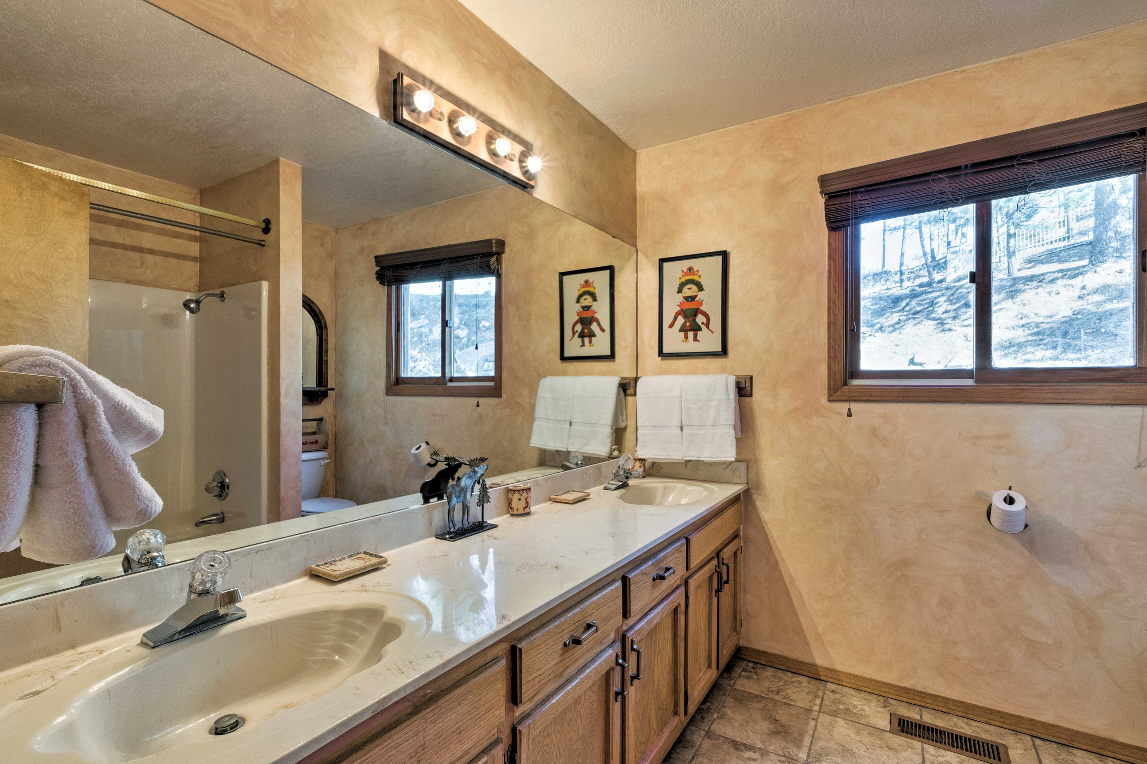 The loft features a full bathroom with double sinks.