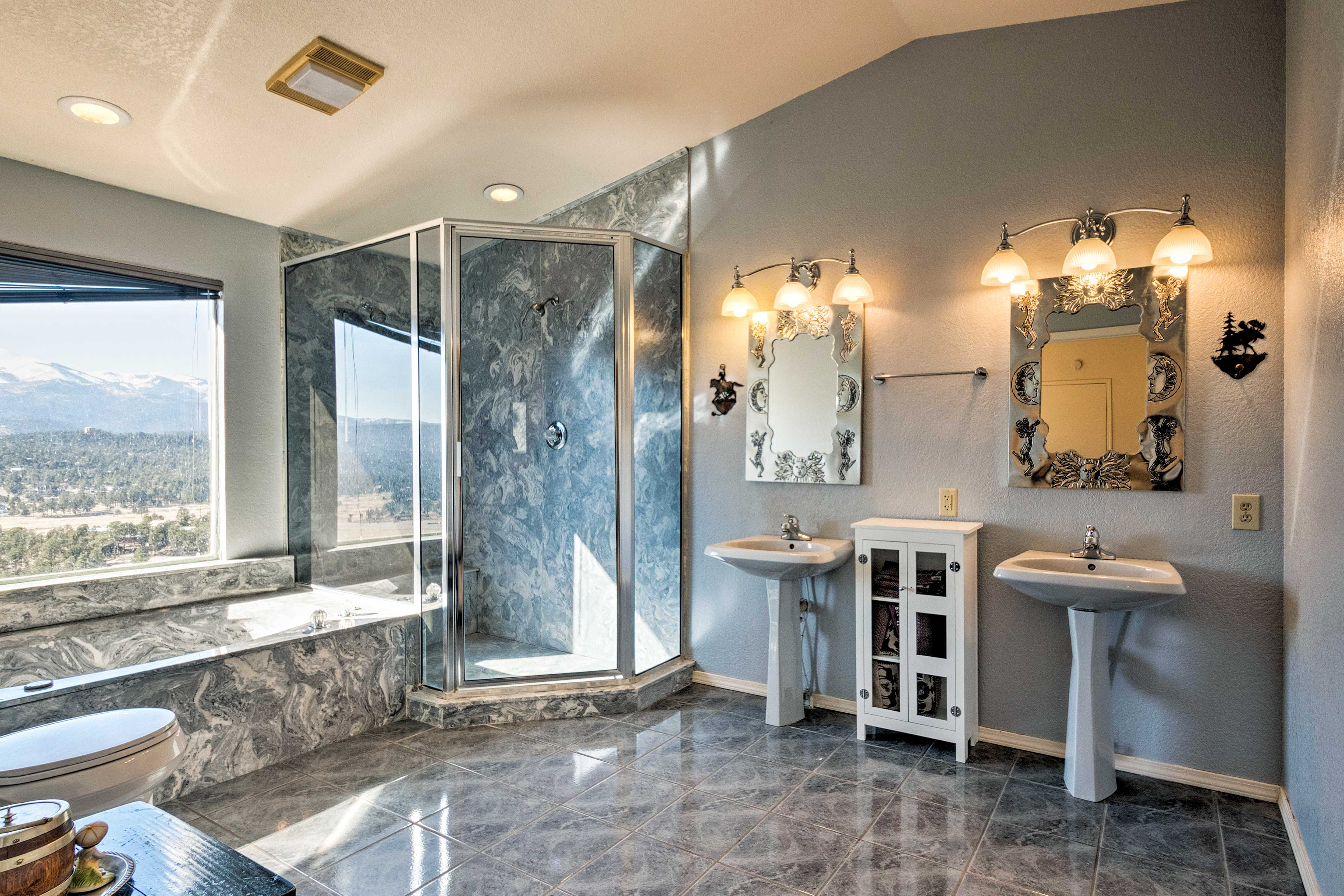 The views continue in the en-suite full bath with a shower & a separate tub.