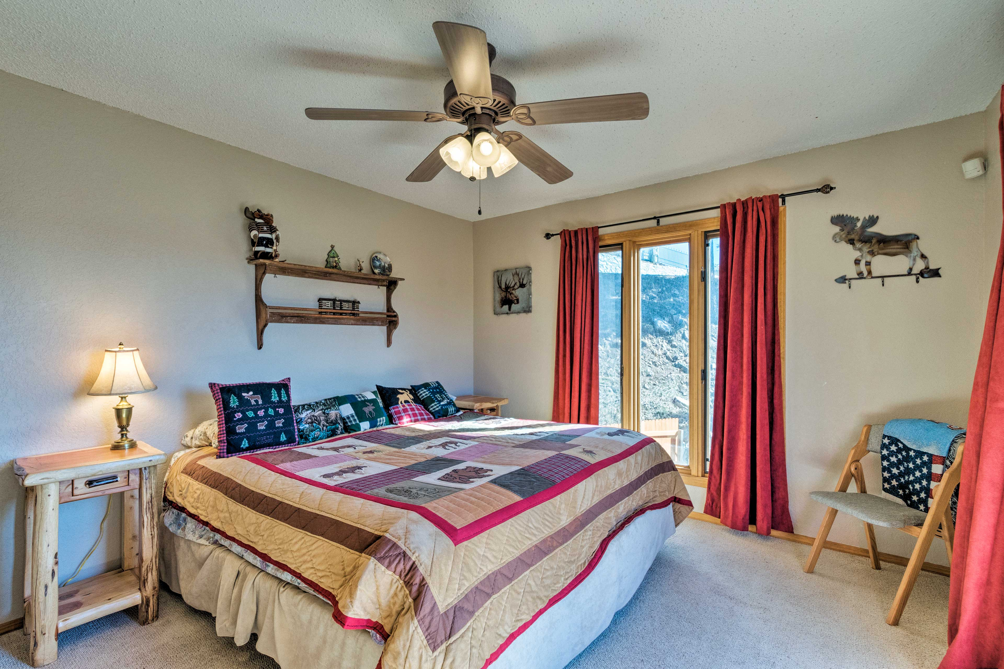 This second bedroom features a king bed and deck access!