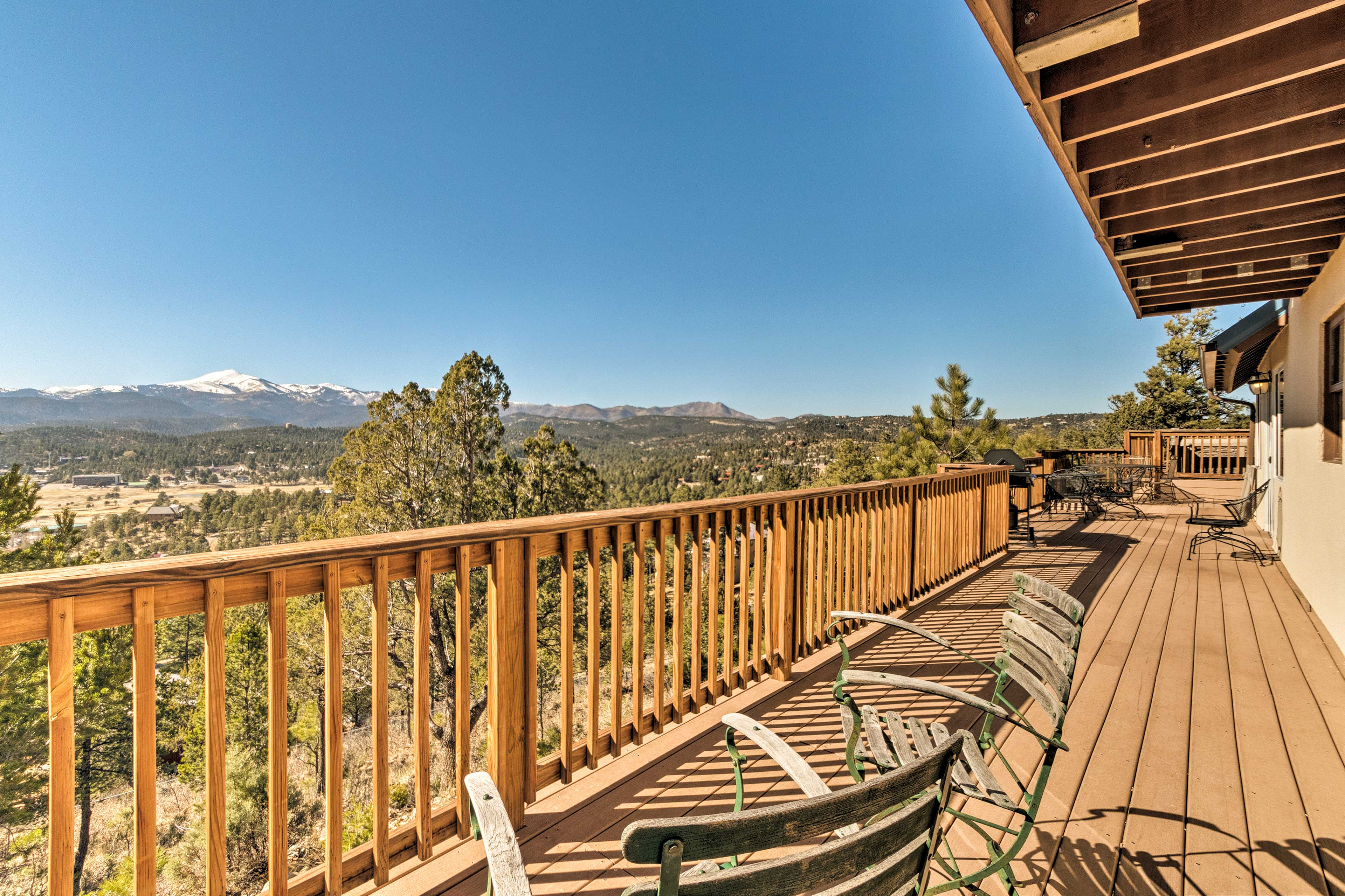 The expansive deck boasts breathtaking views of the New Mexico mountains.
