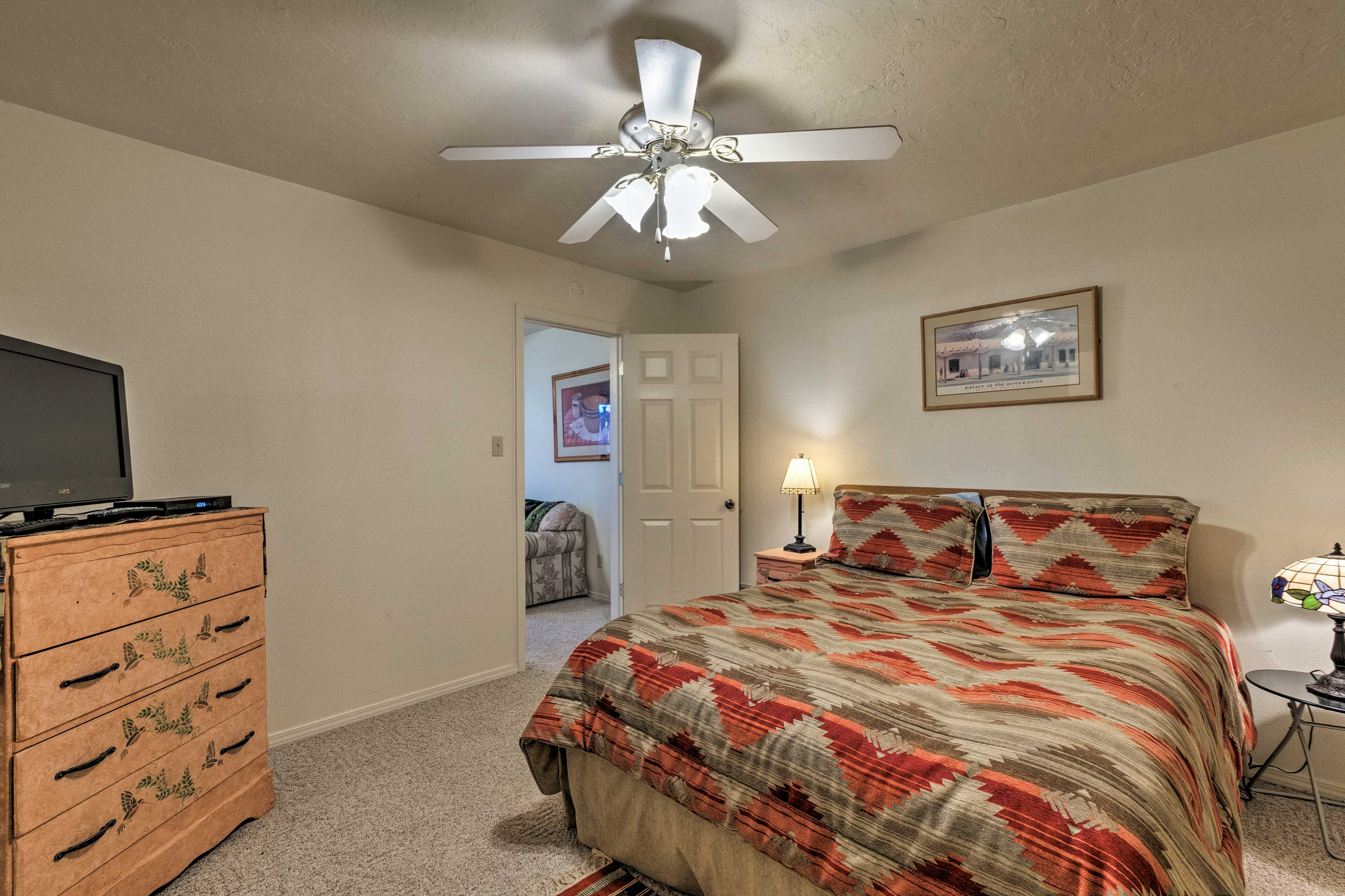A private suite downstairs features a queen bed in the bedroom.