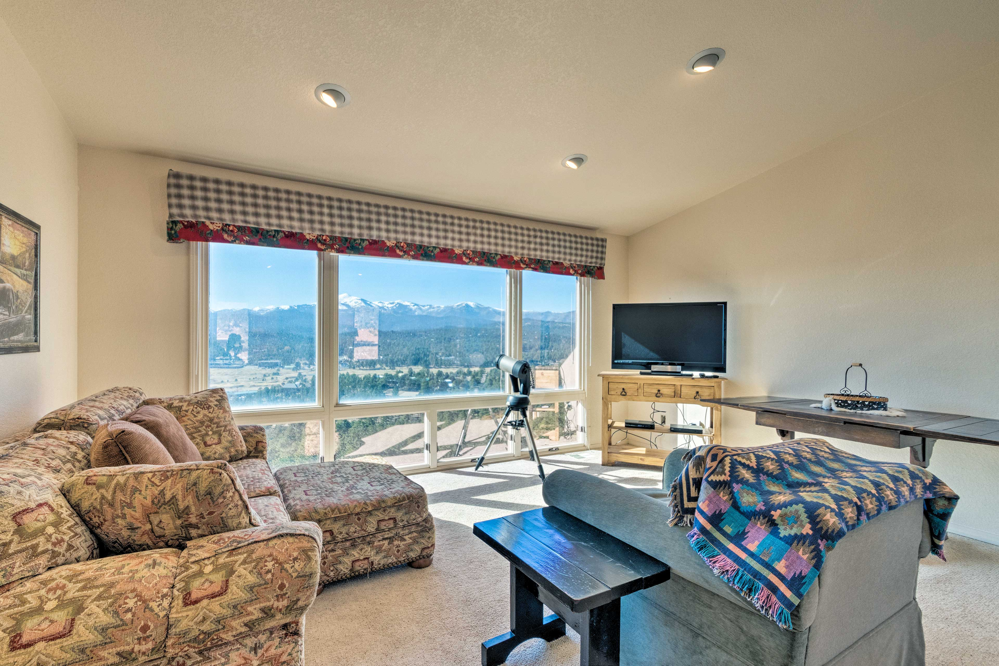 The seating area allows a closer look at the breathtaking mountain view.
