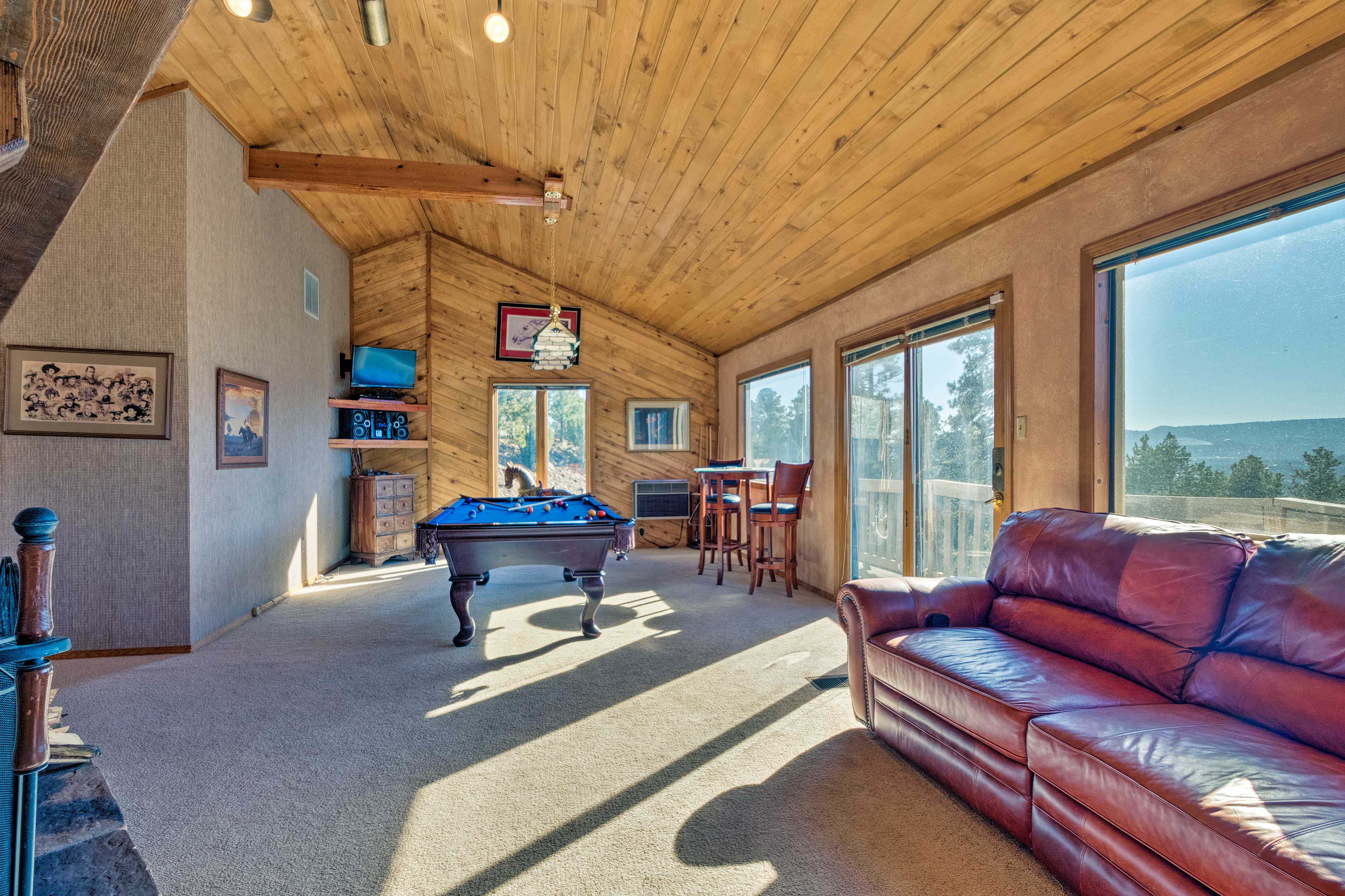 Upstairs, the game loft boasts stunning views and deck access.