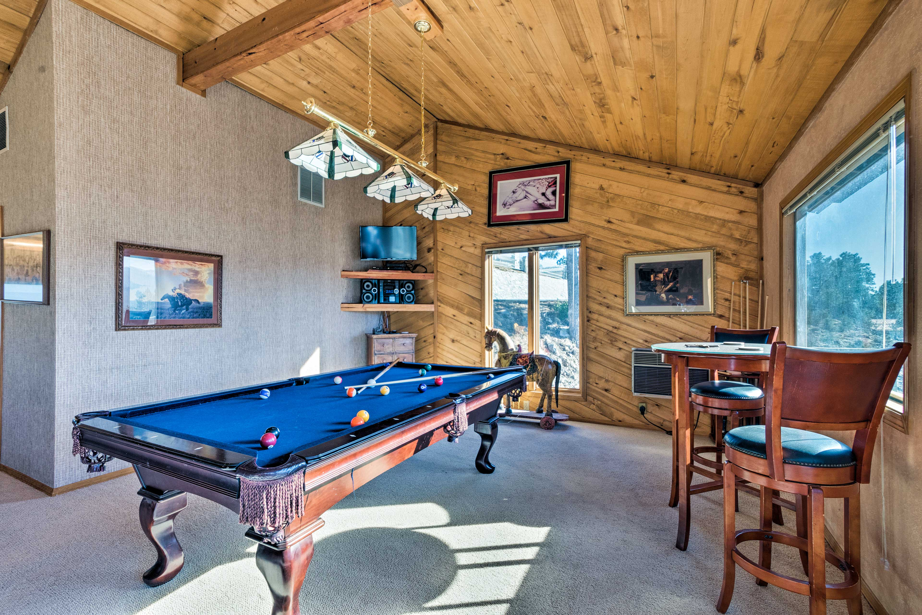 Place some pool or watch a game on the flat-screen TV.