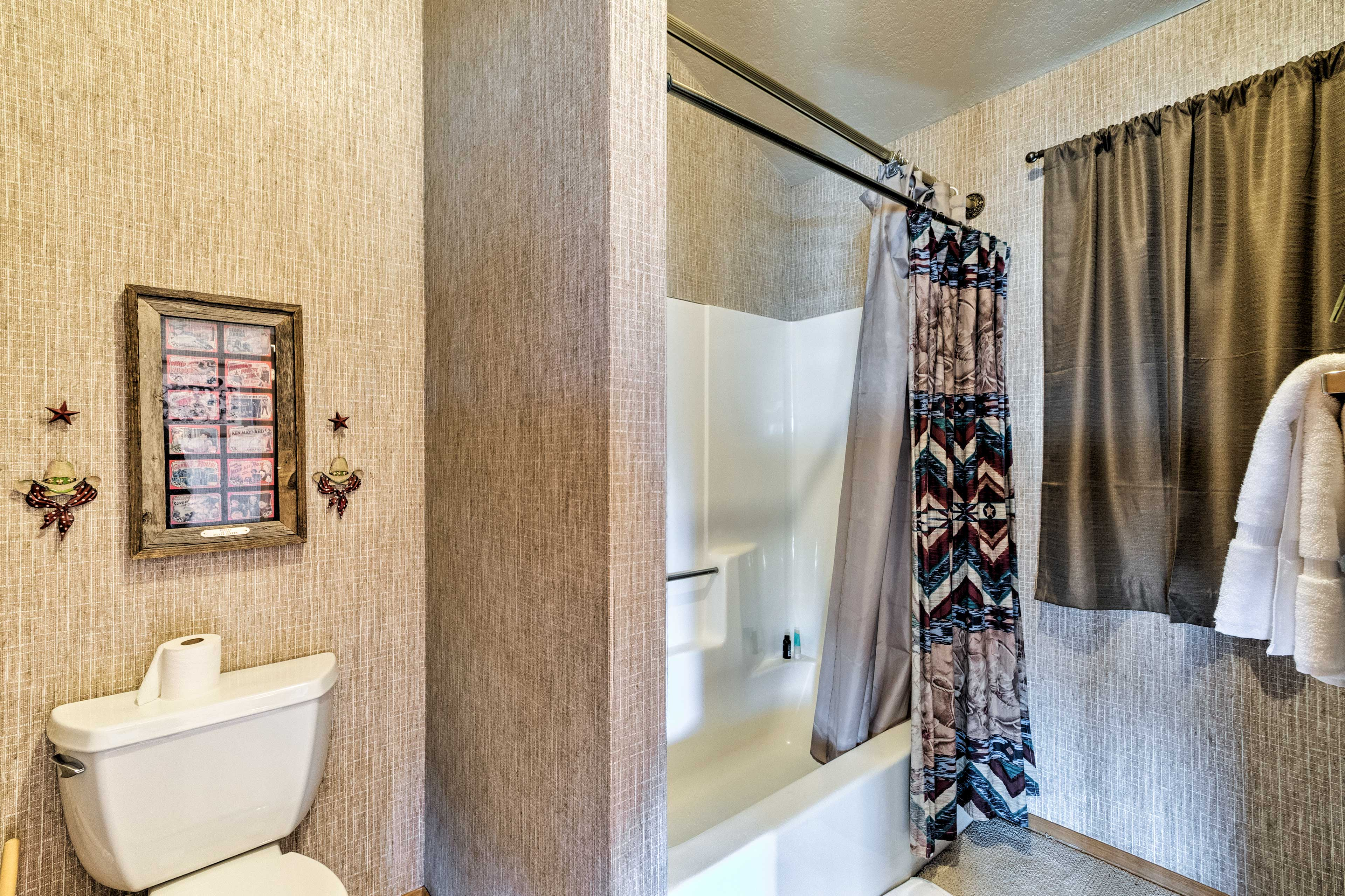 A third full bathroom hosts this shower/tub combo.