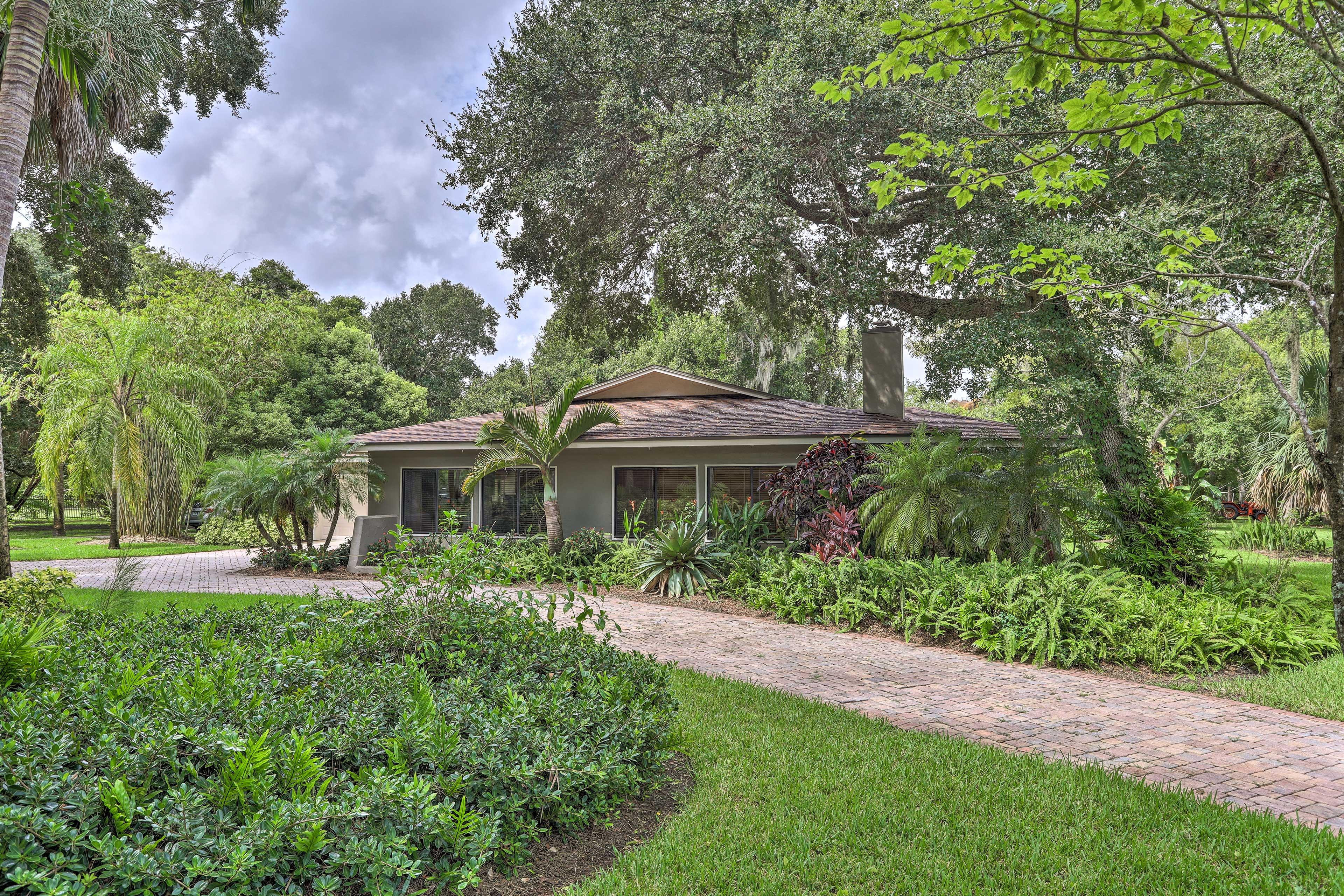 Lush tropical foliage surrounds this hidden home in Merritt Island, FL.
