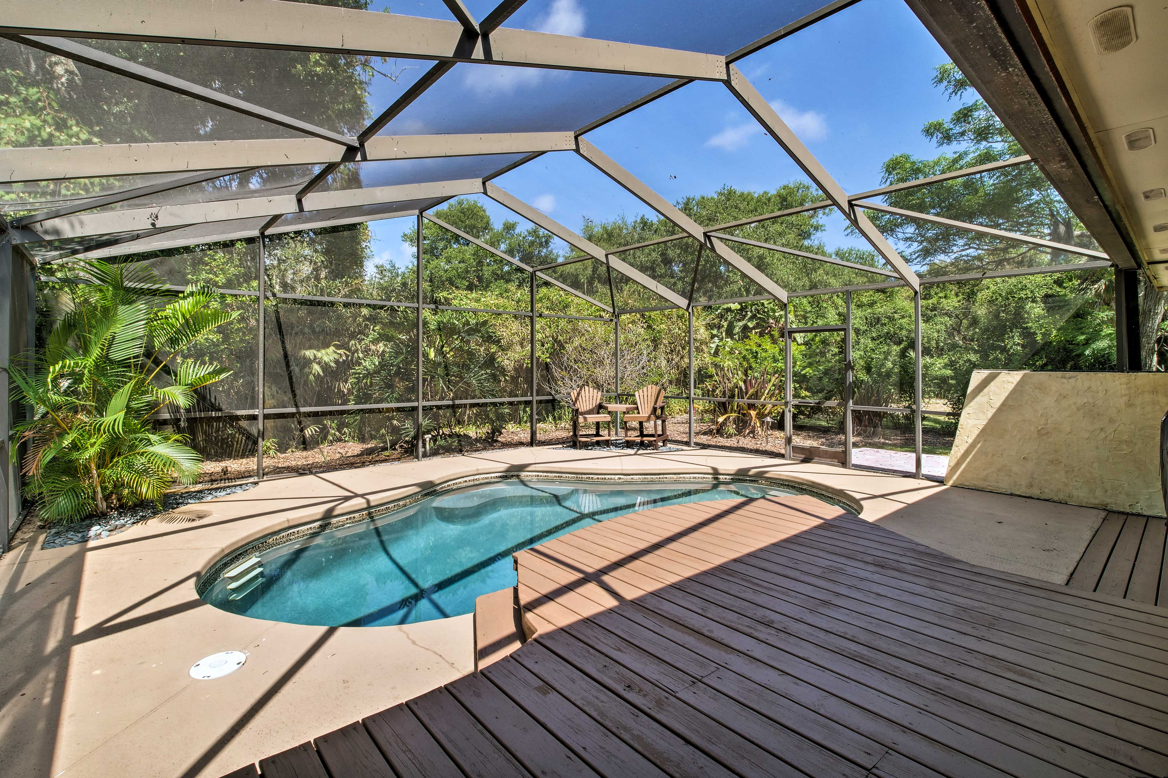Enjoy the privacy of a secluded screened-in pool and spacious deck.