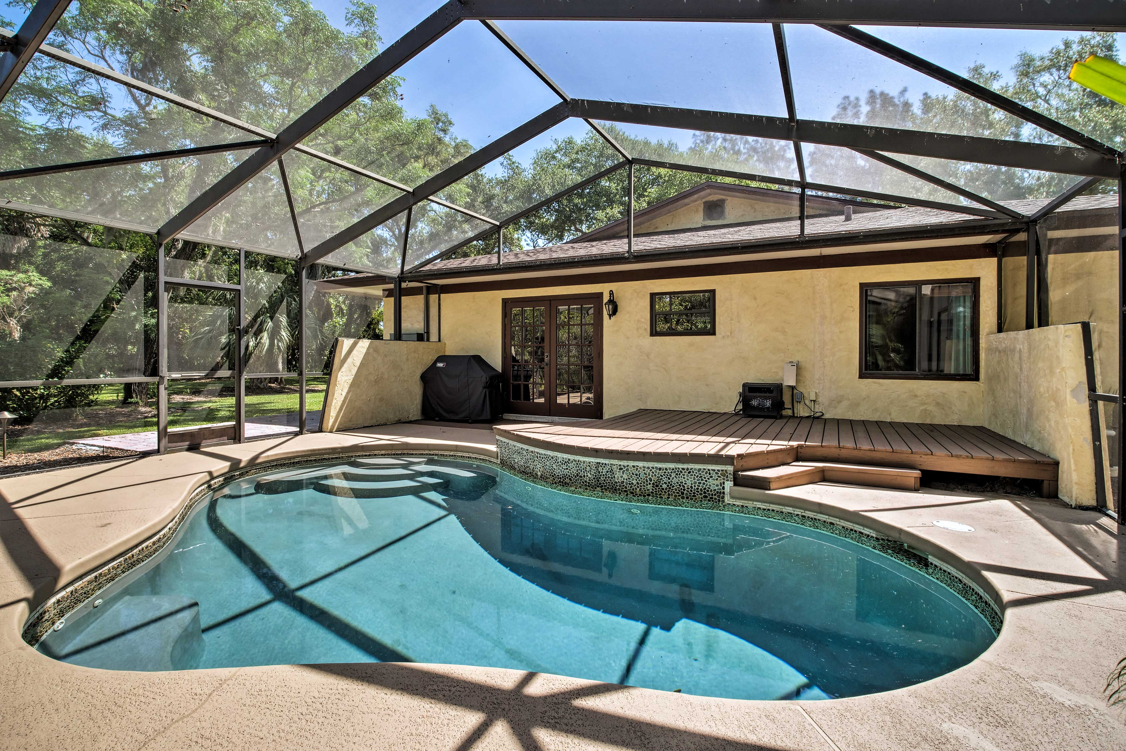 Up to 7 of you can escape to this Florida oasis, featuring a screened-in pool.