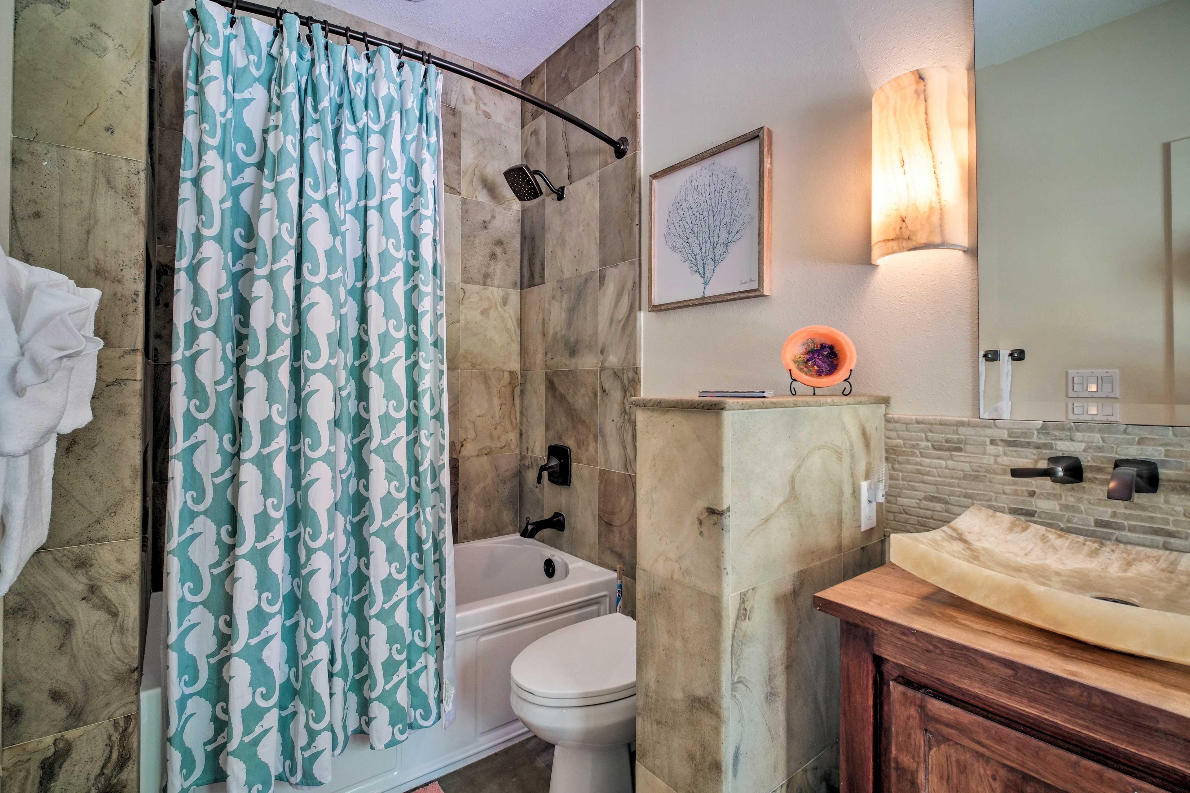 You will love rinsing off in this immaculate bathroom.