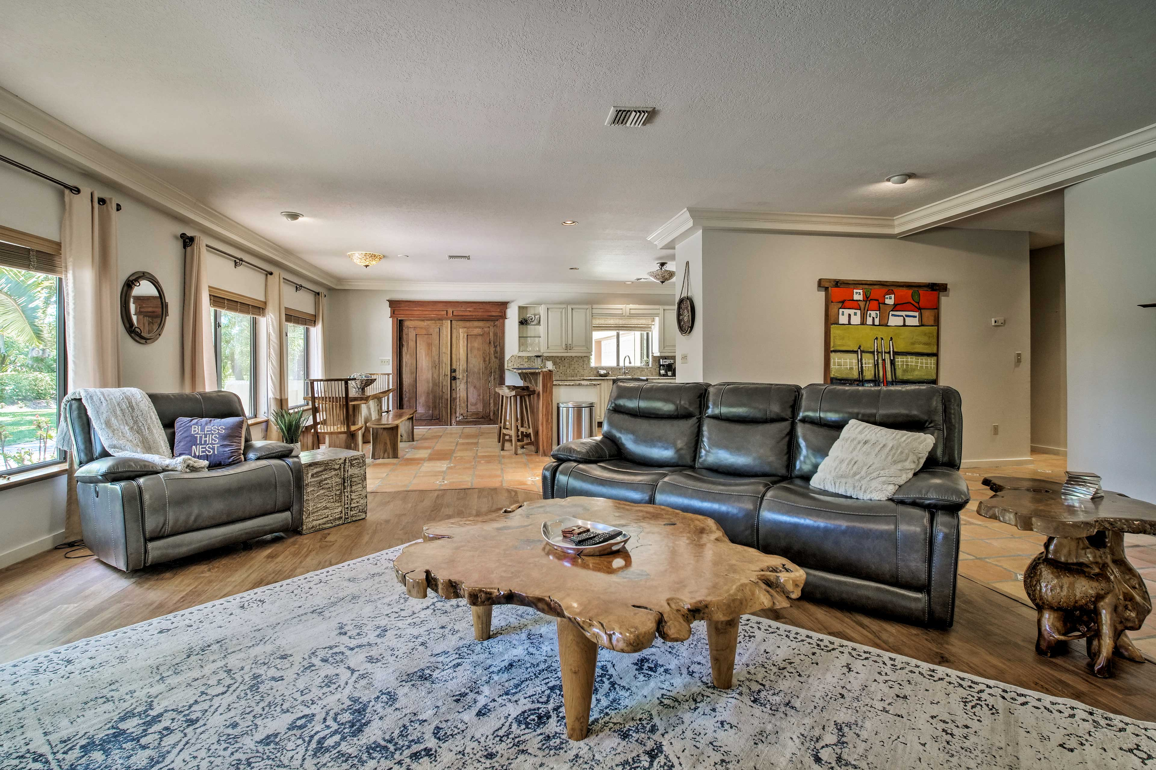 Wood accents complete this beautiful 3-bed, 3-bath vacation rental for up to 7!