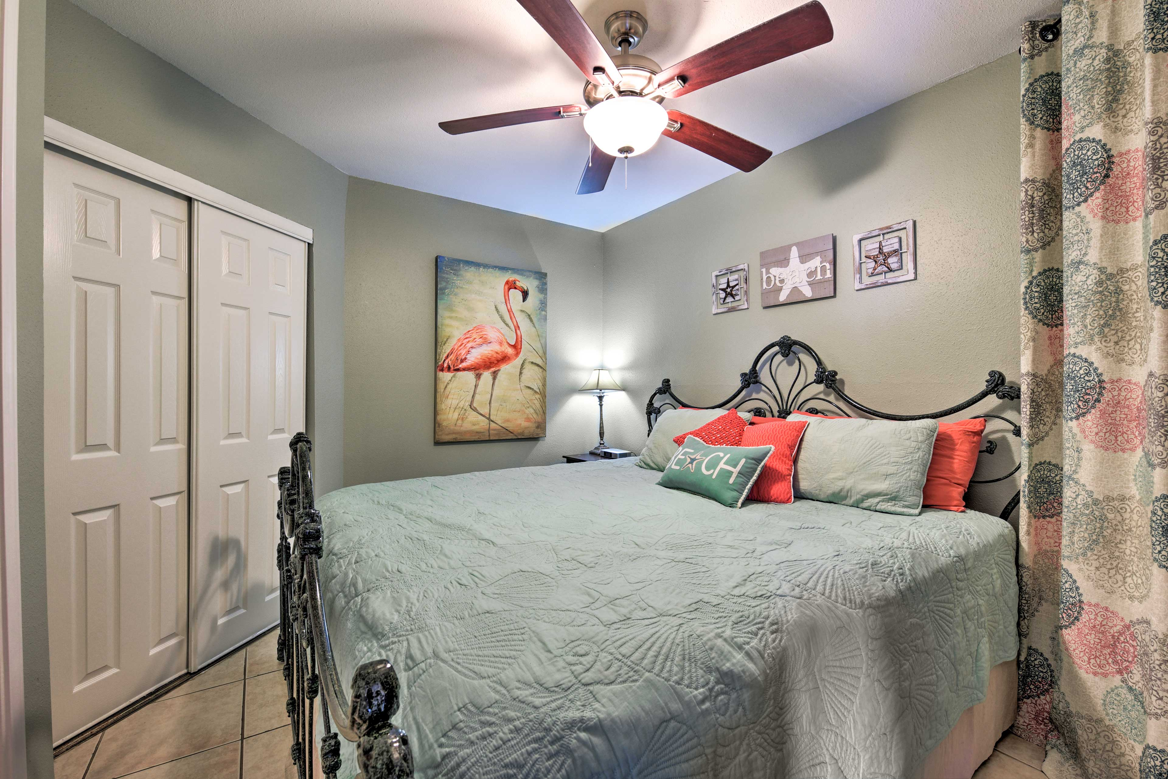 The bedroom houses a king bed.