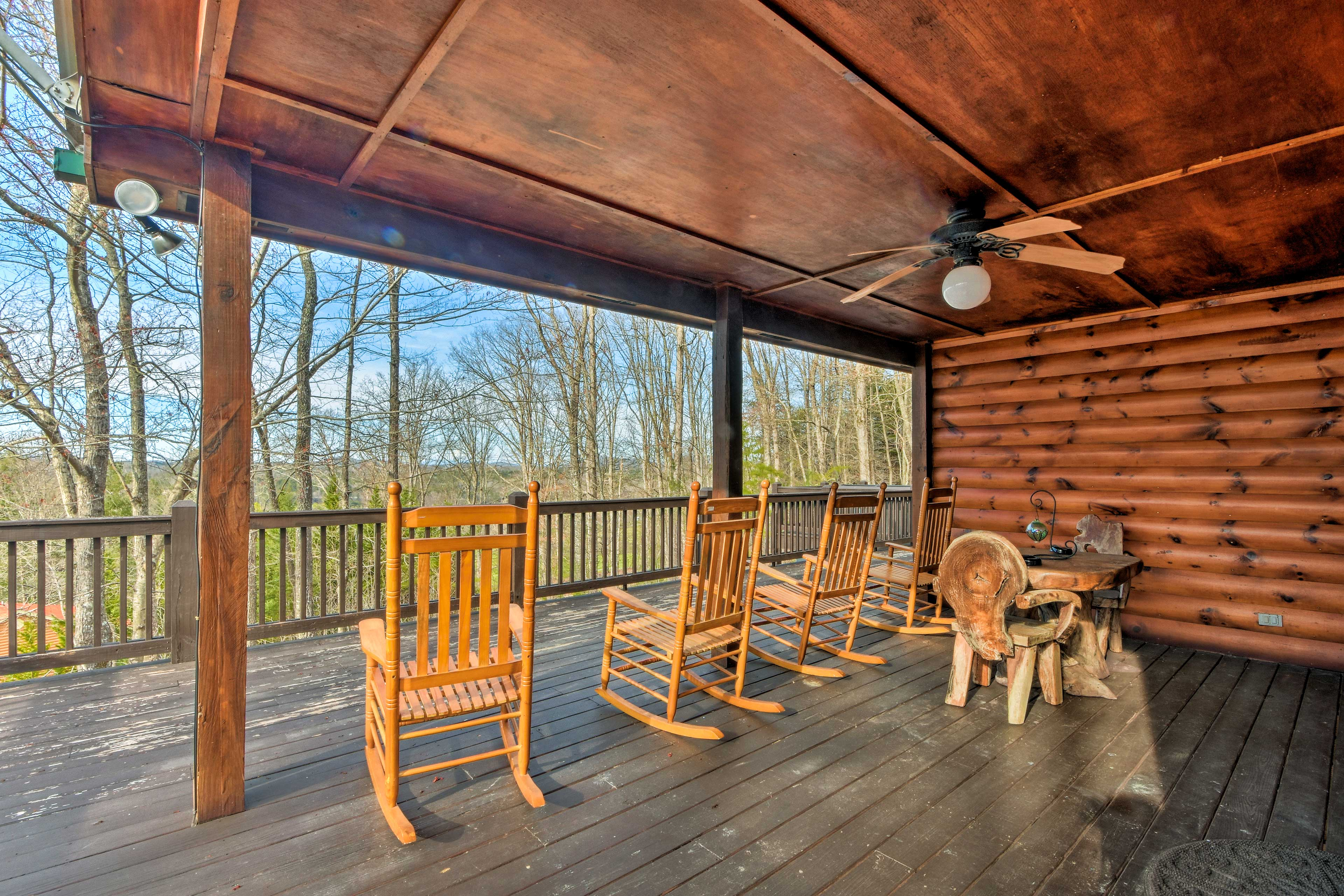 The spacious home boasts mountain views from the deck and hot tub.