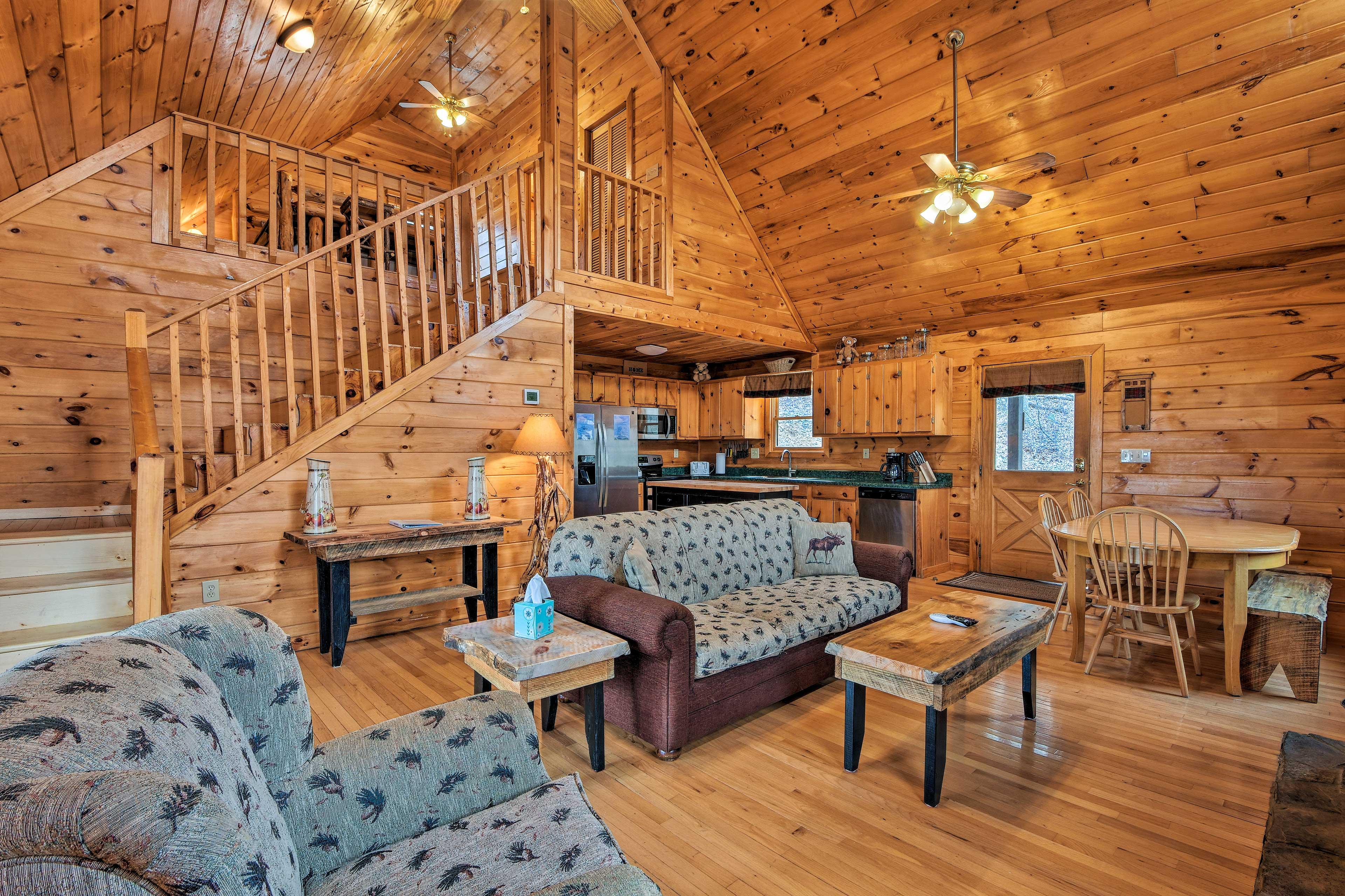 Hardwood floors and wood-paneled walls create a cozy cabin interior.