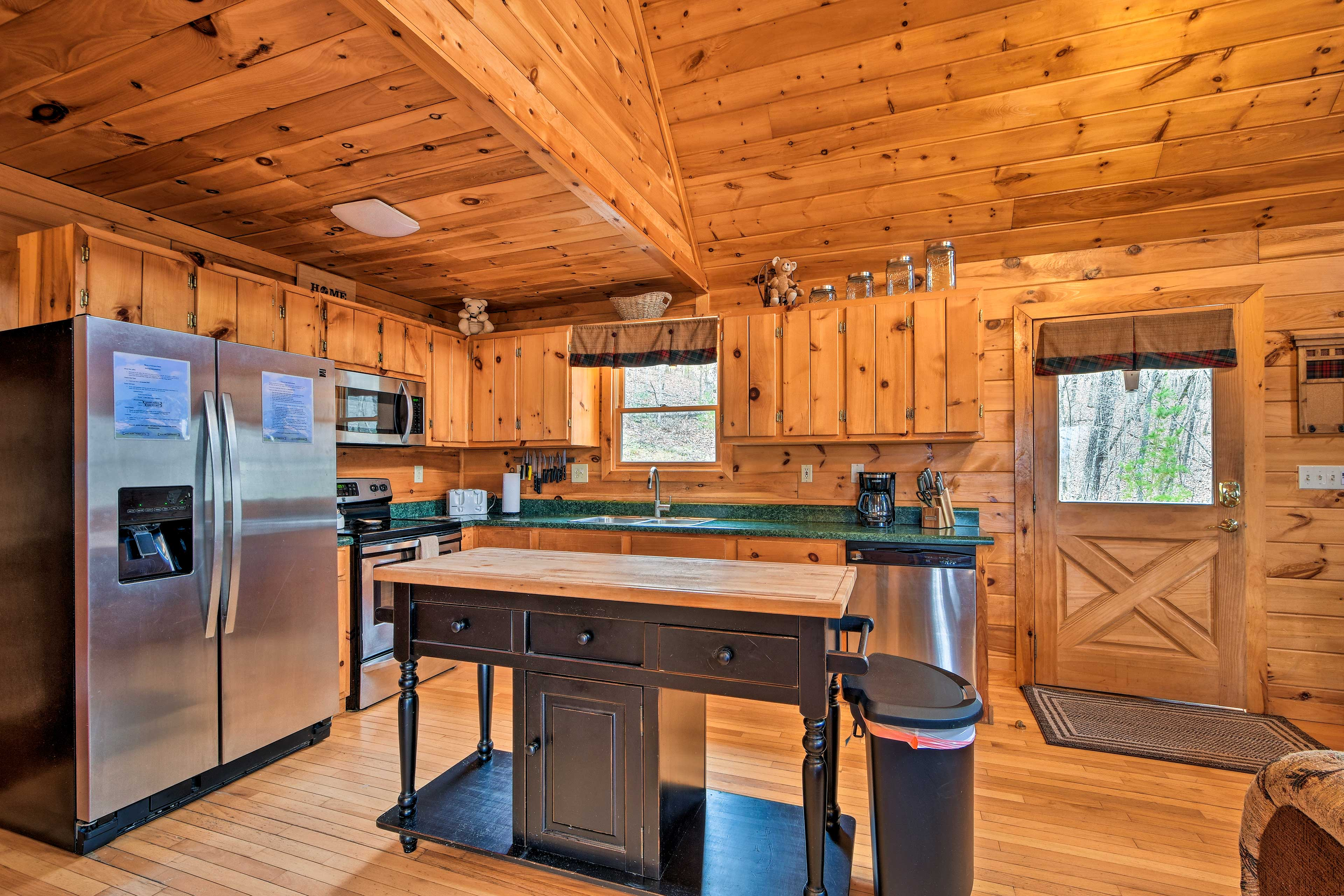 Stainless steel appliances and a kitchen island complete the space.
