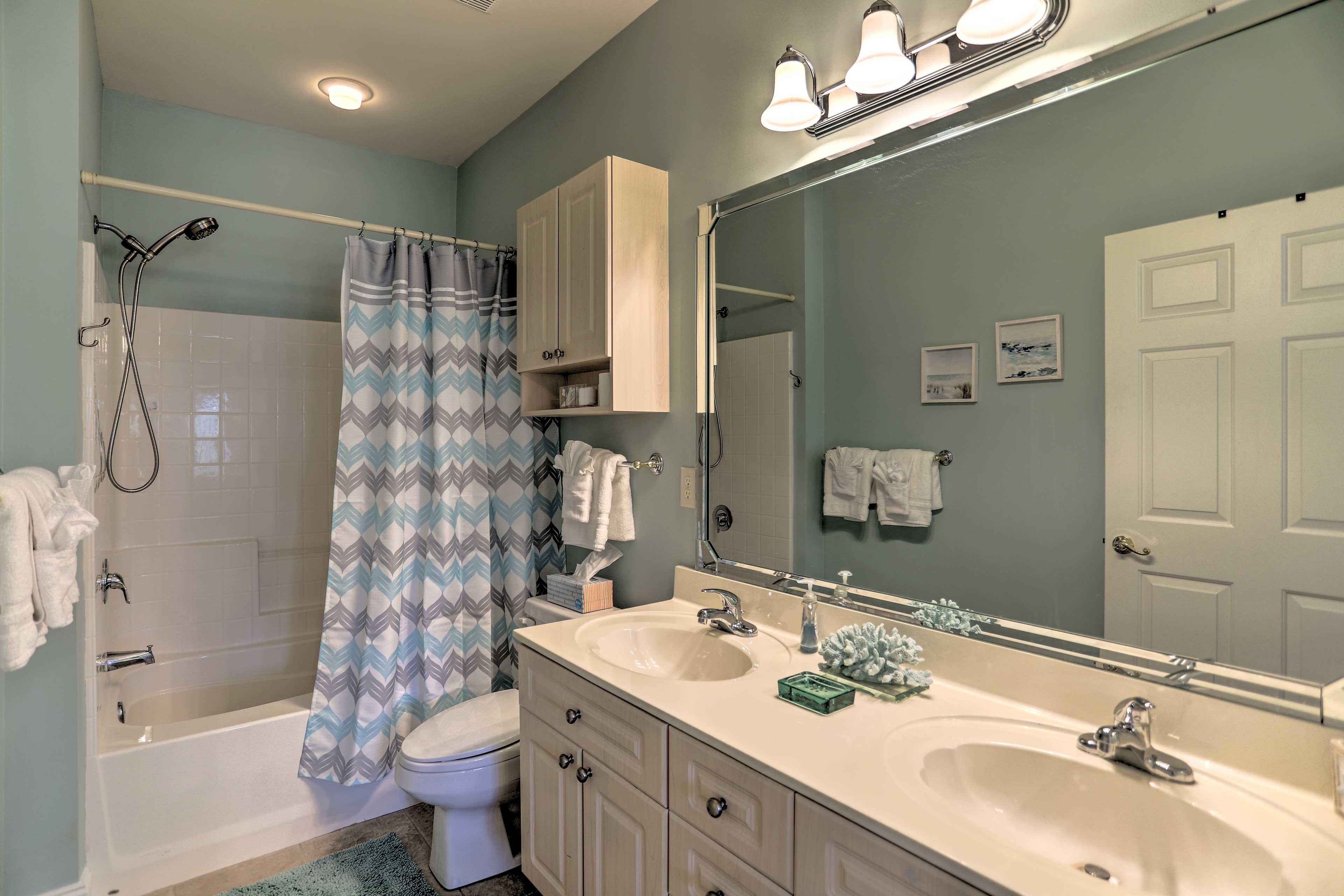 Freshen up in the en-suite bathroom.