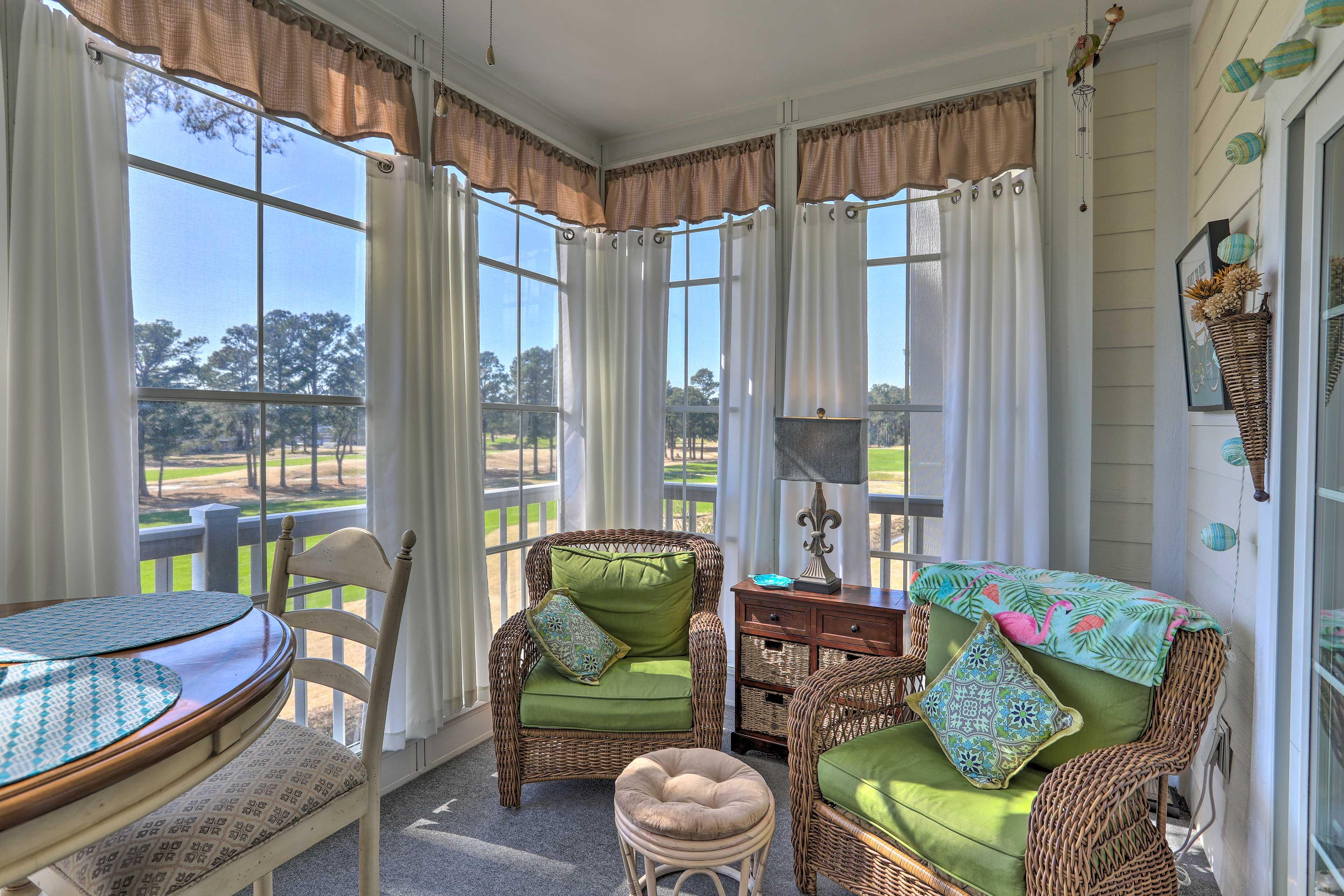 Natural light illuminates the bright and breezy sunroom!