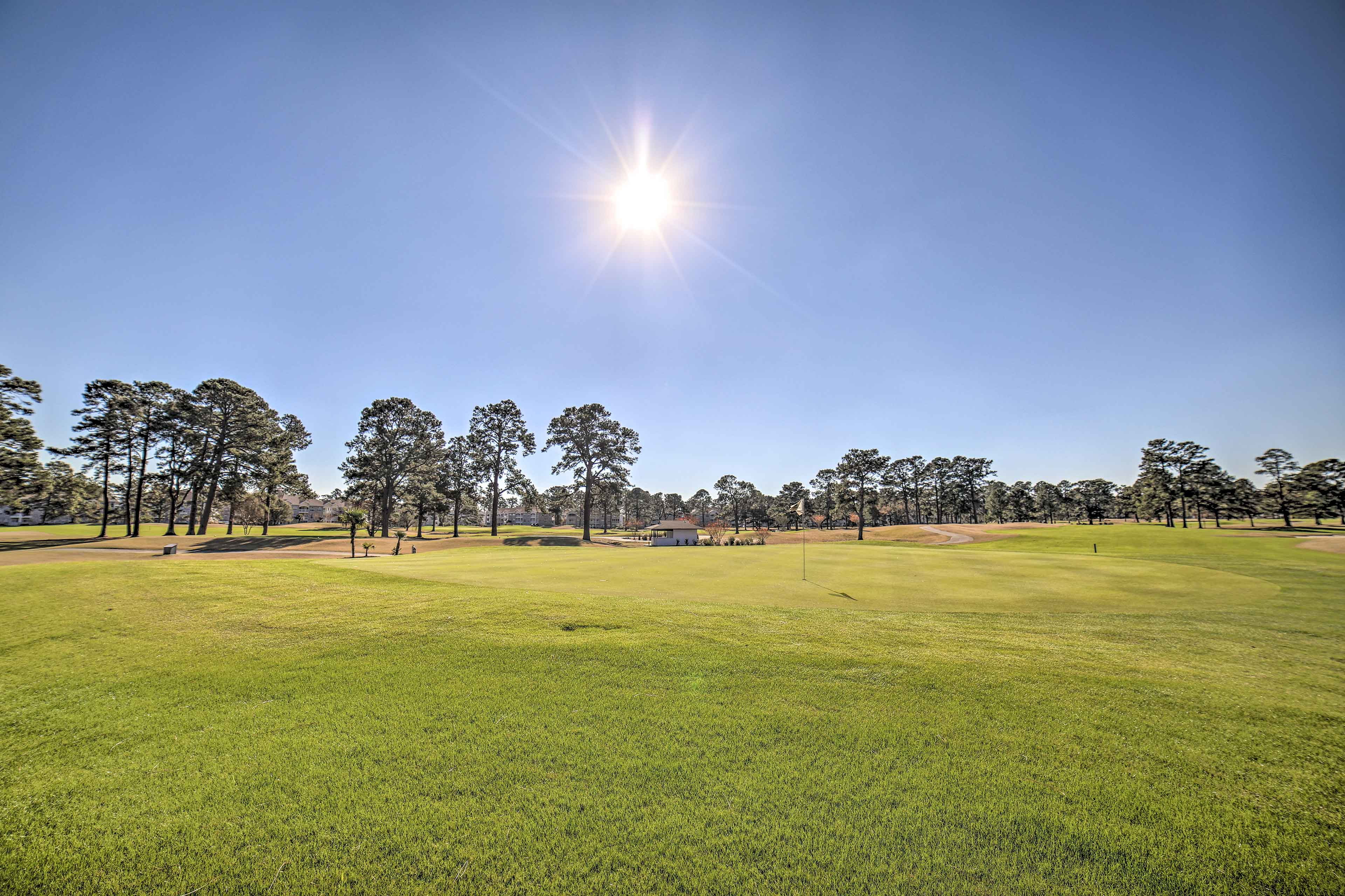 This vacation rental is perched on the edge of the Myrtlewood Golf Club.