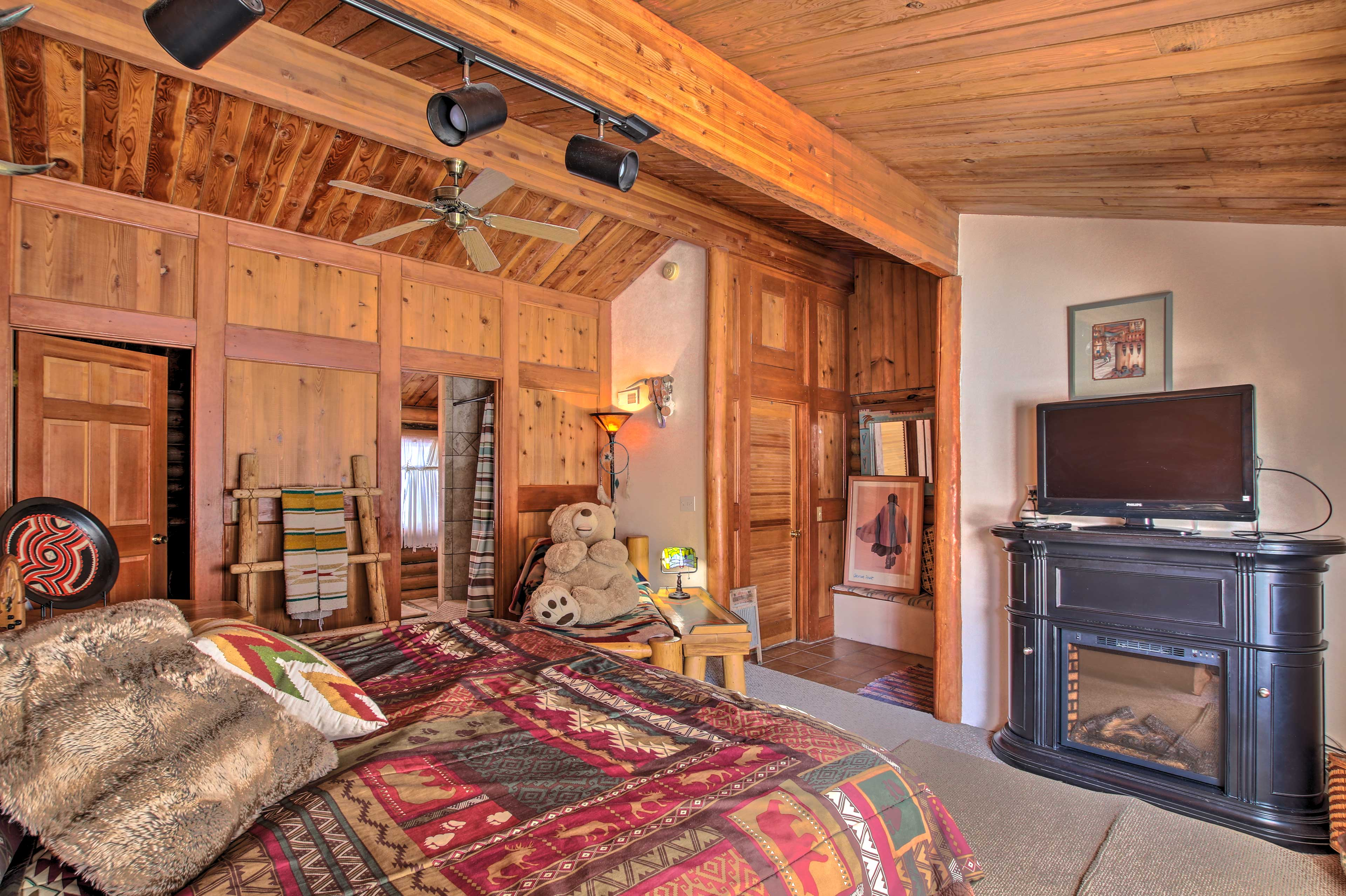 Turn on the fireplace and watch a show on the flat-screen TV.