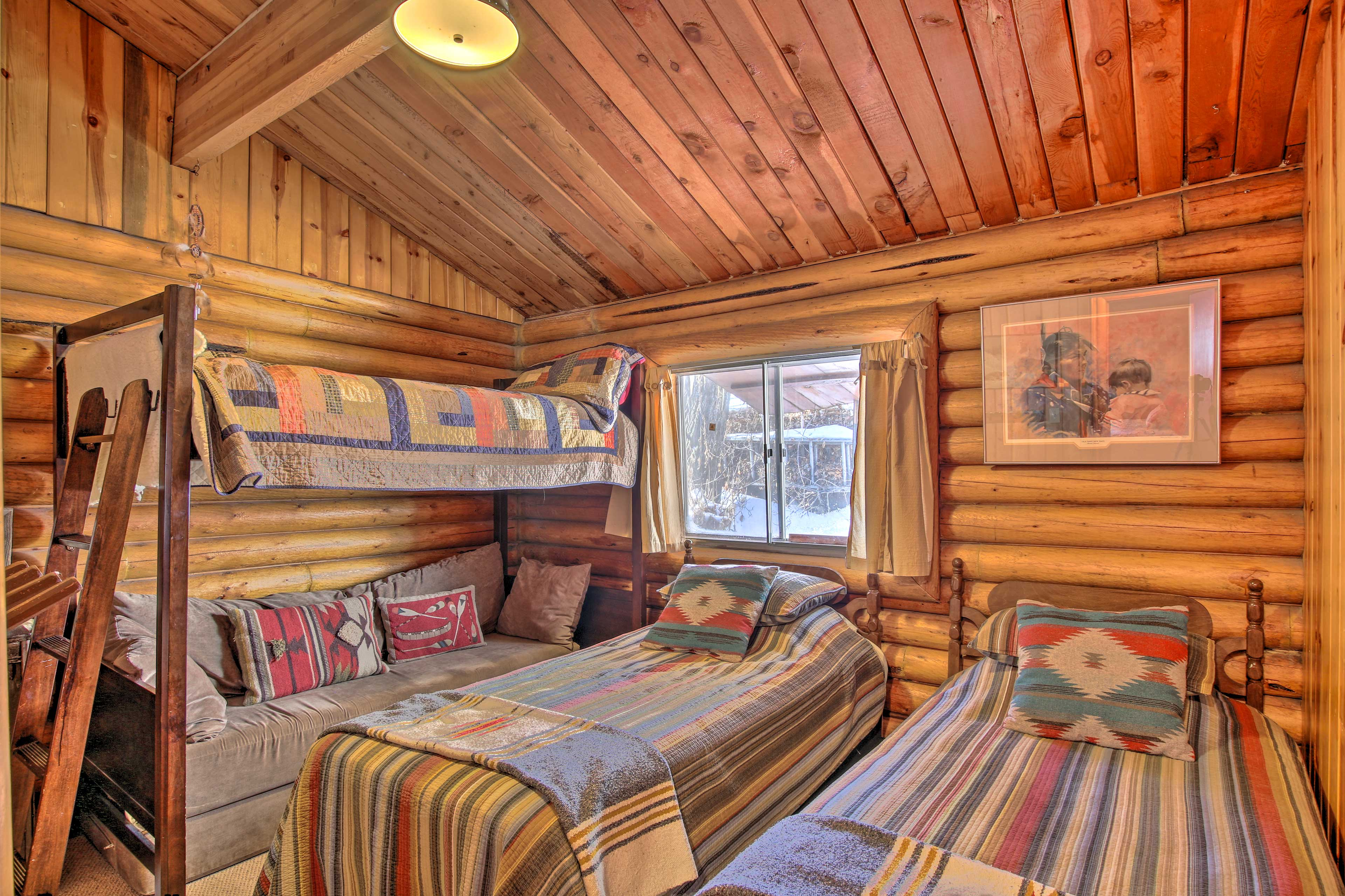 This room features a twin-over-twin bunk bed.