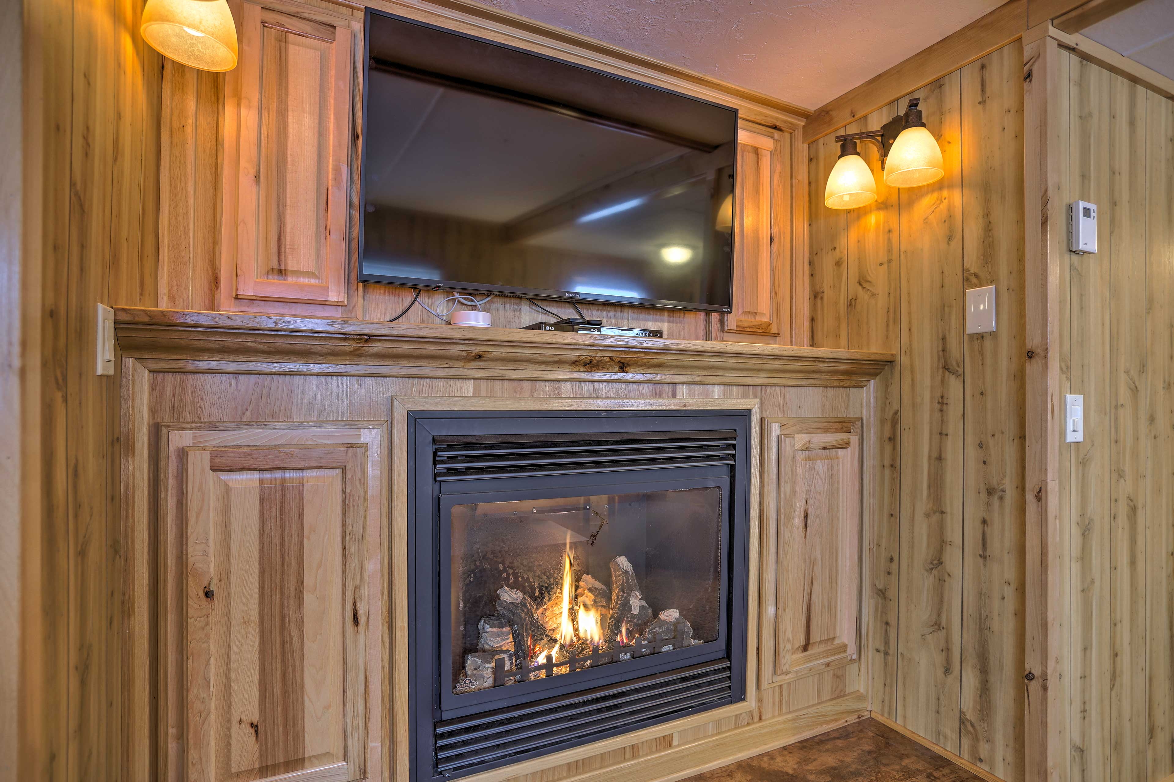 Turn on the fireplace and let the warmth fill the room.