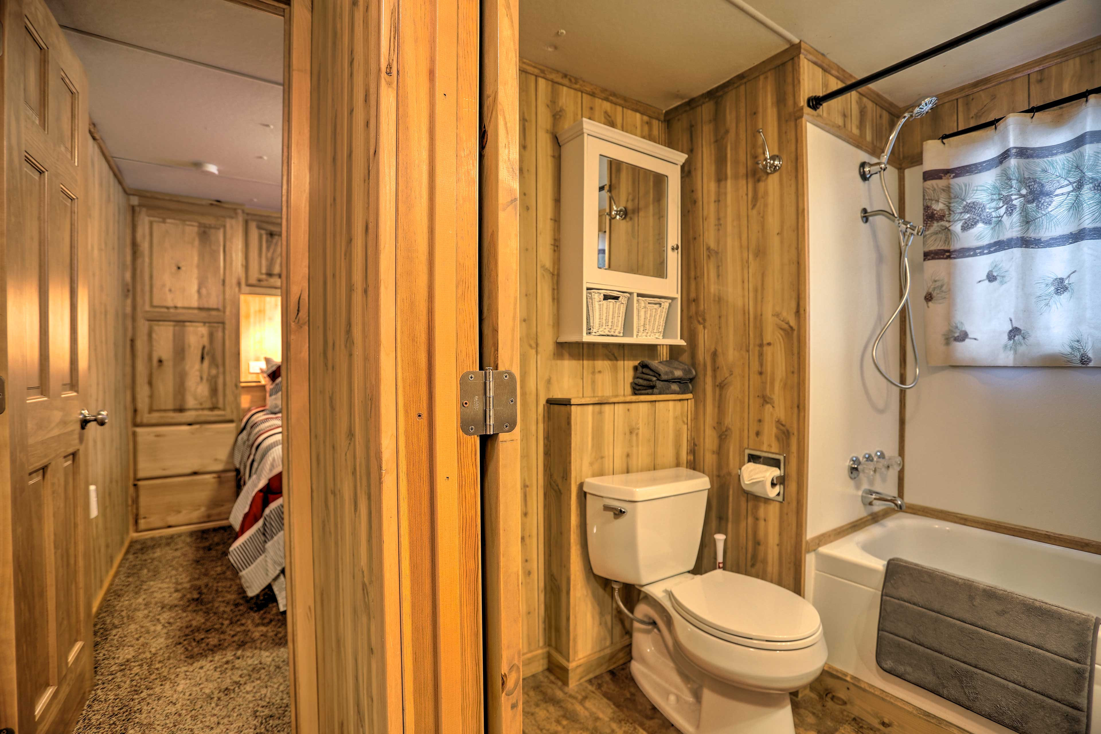 The bathroom is mere steps from the bedroom.