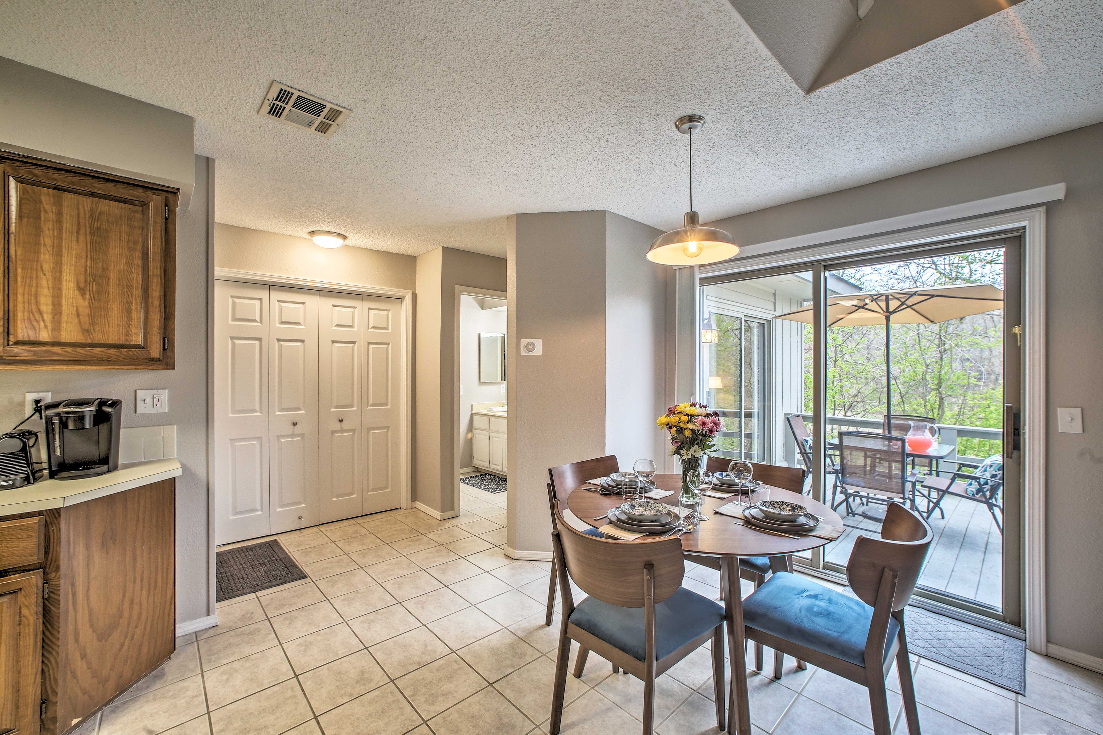 The balcony and one of the bathrooms is located off of this main living space.