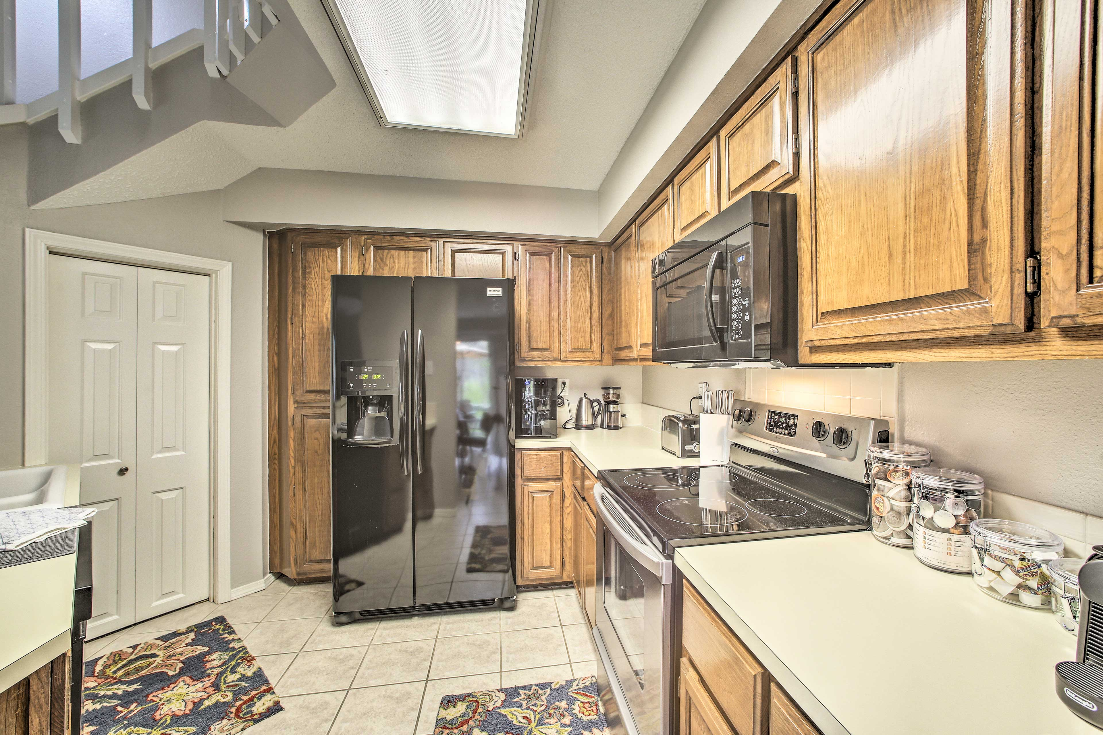 The kitchen comes fully equipped to handle all of your home-cooking needs.