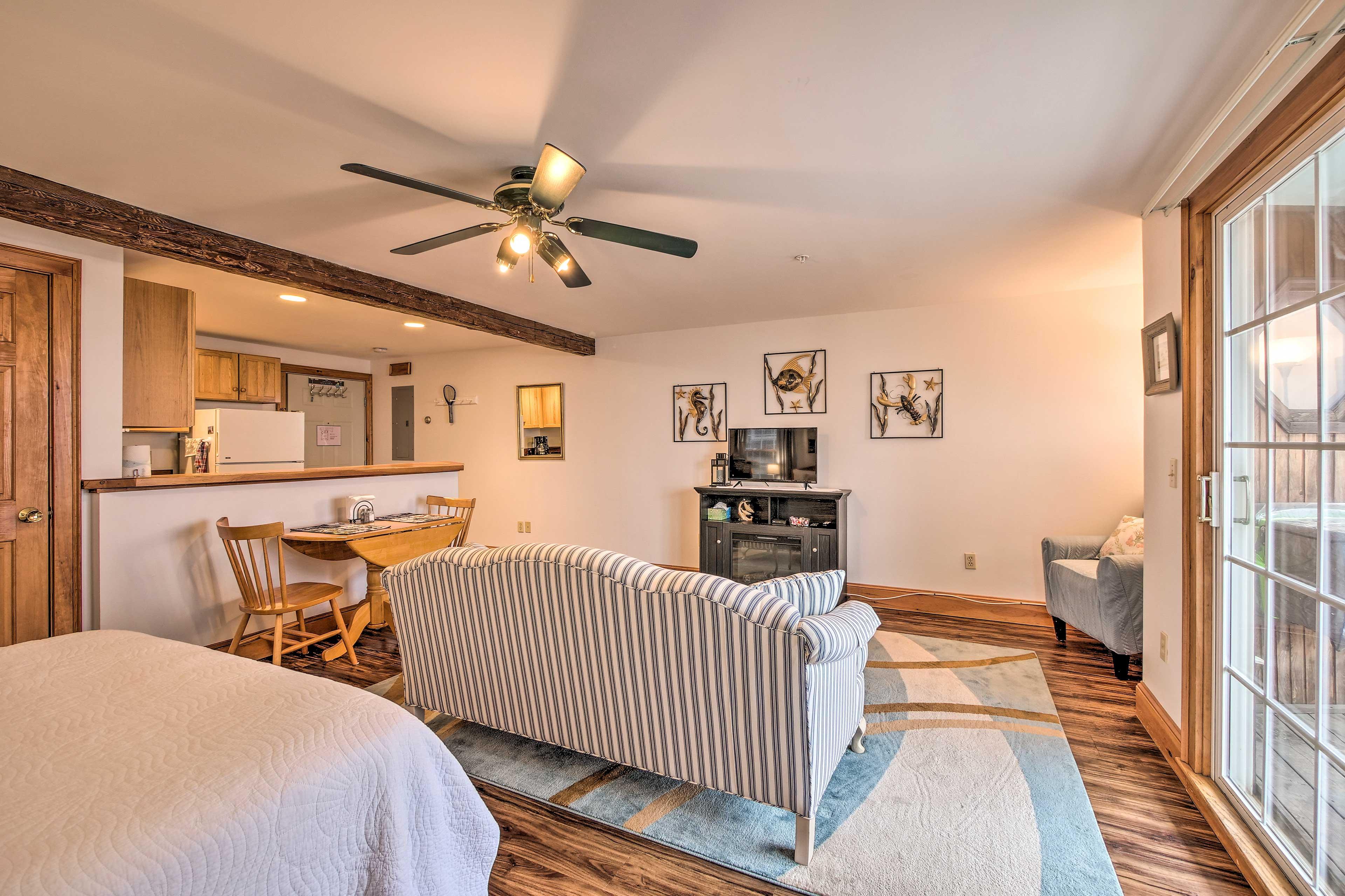 The open floor plan features exposed wood beams & tasteful decor.