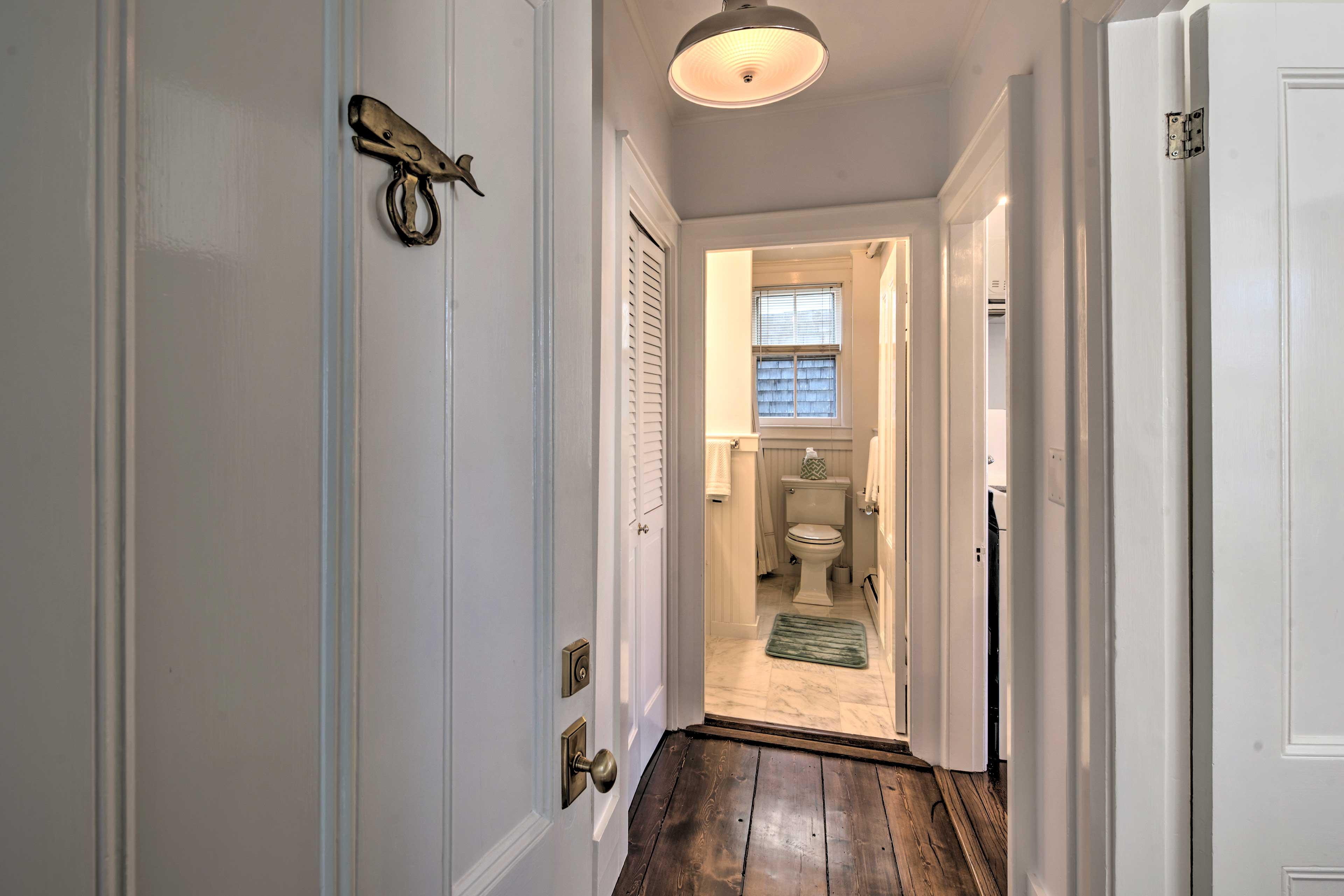 Admire the unique whale knocker no the door as you walk through it.
