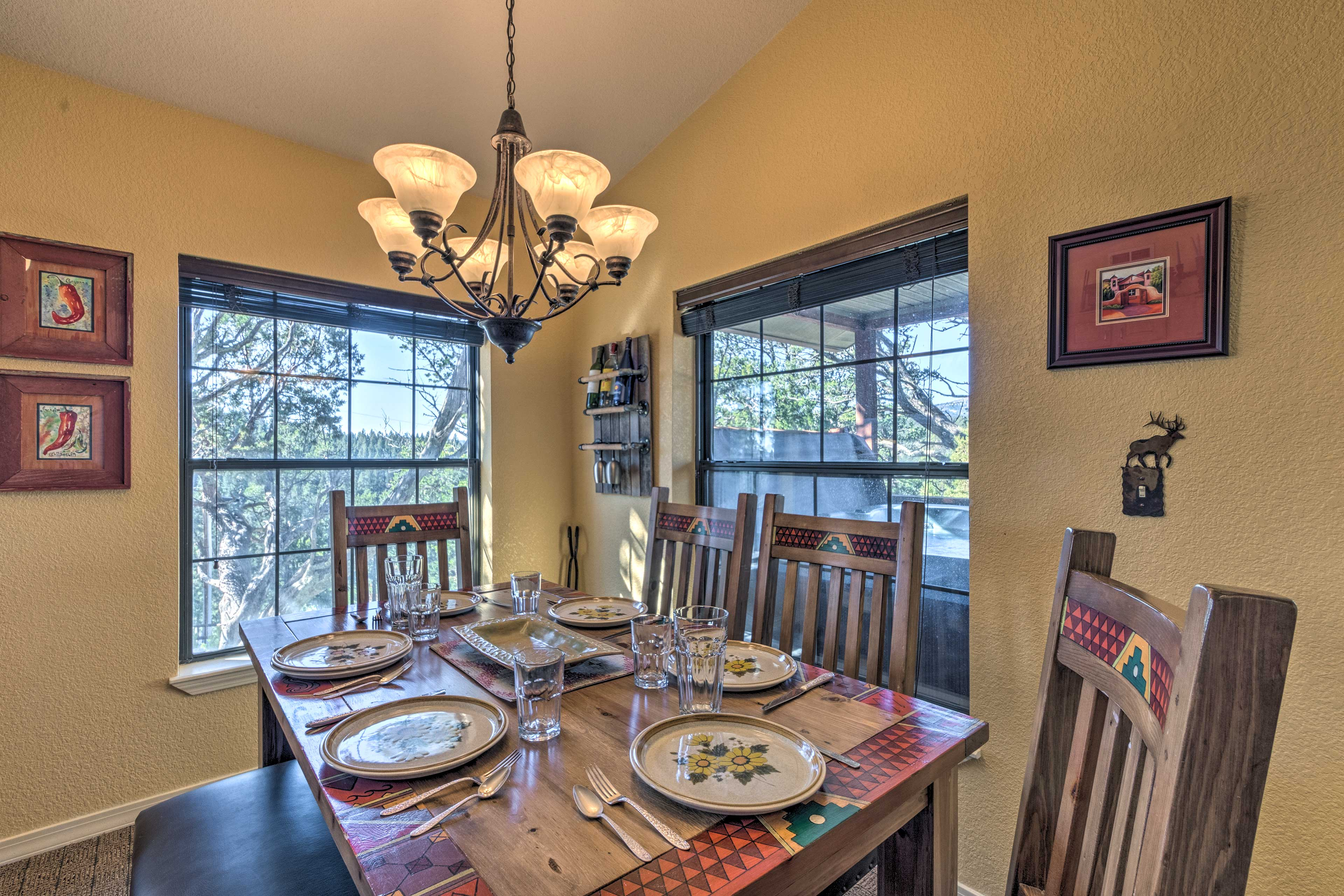 Gather the group for a family dinner around the elegant dining table.