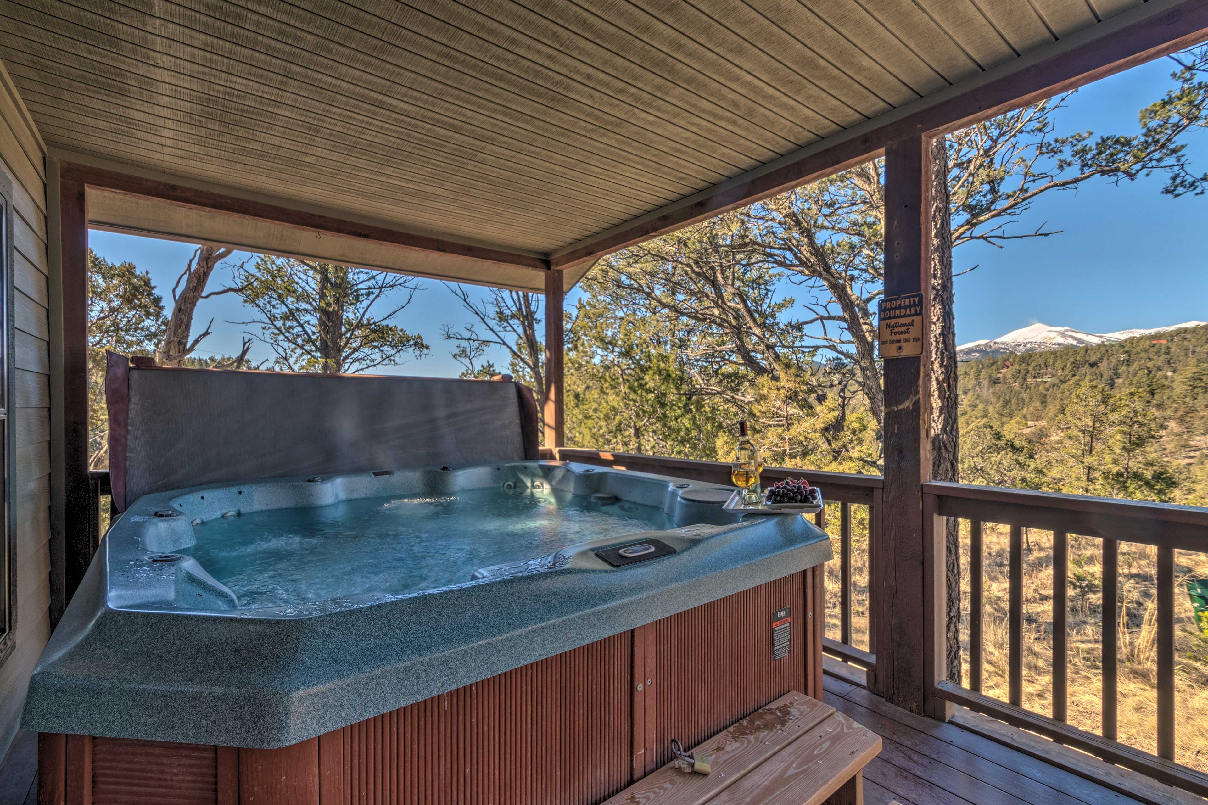 Soak up the fresh mountain air from the private hot tub with mountain views!
