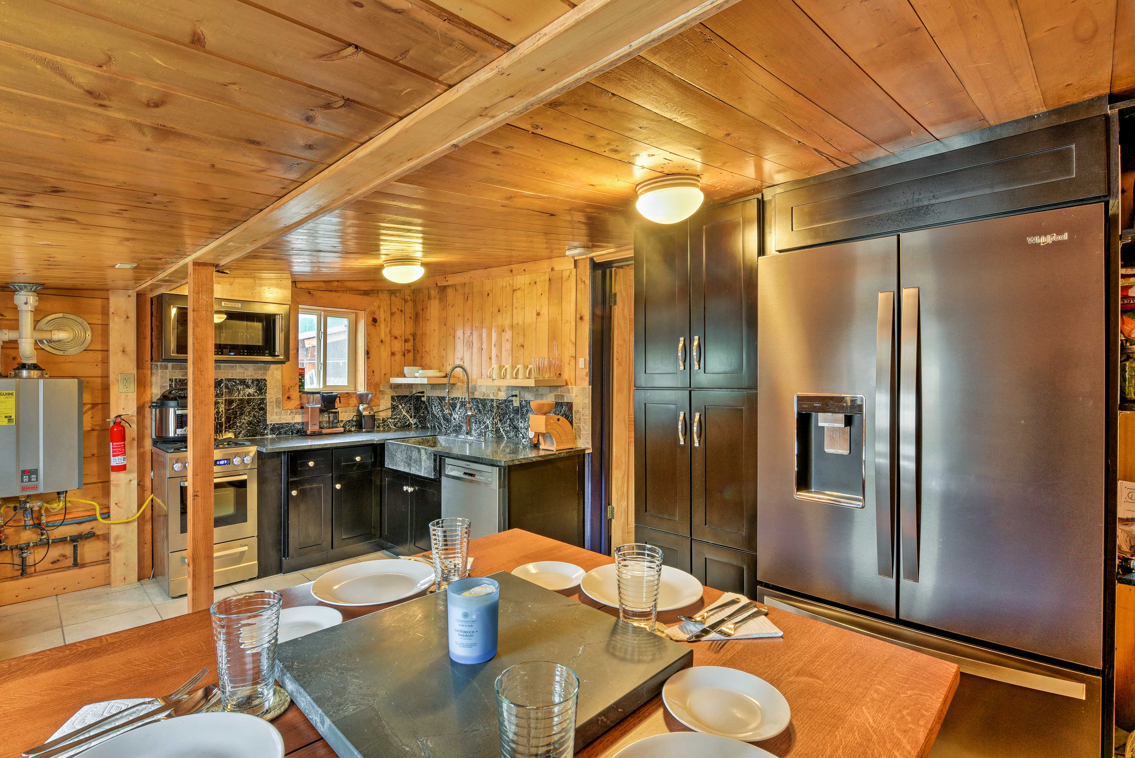 This space offers stainless steel appliances and long countertops.