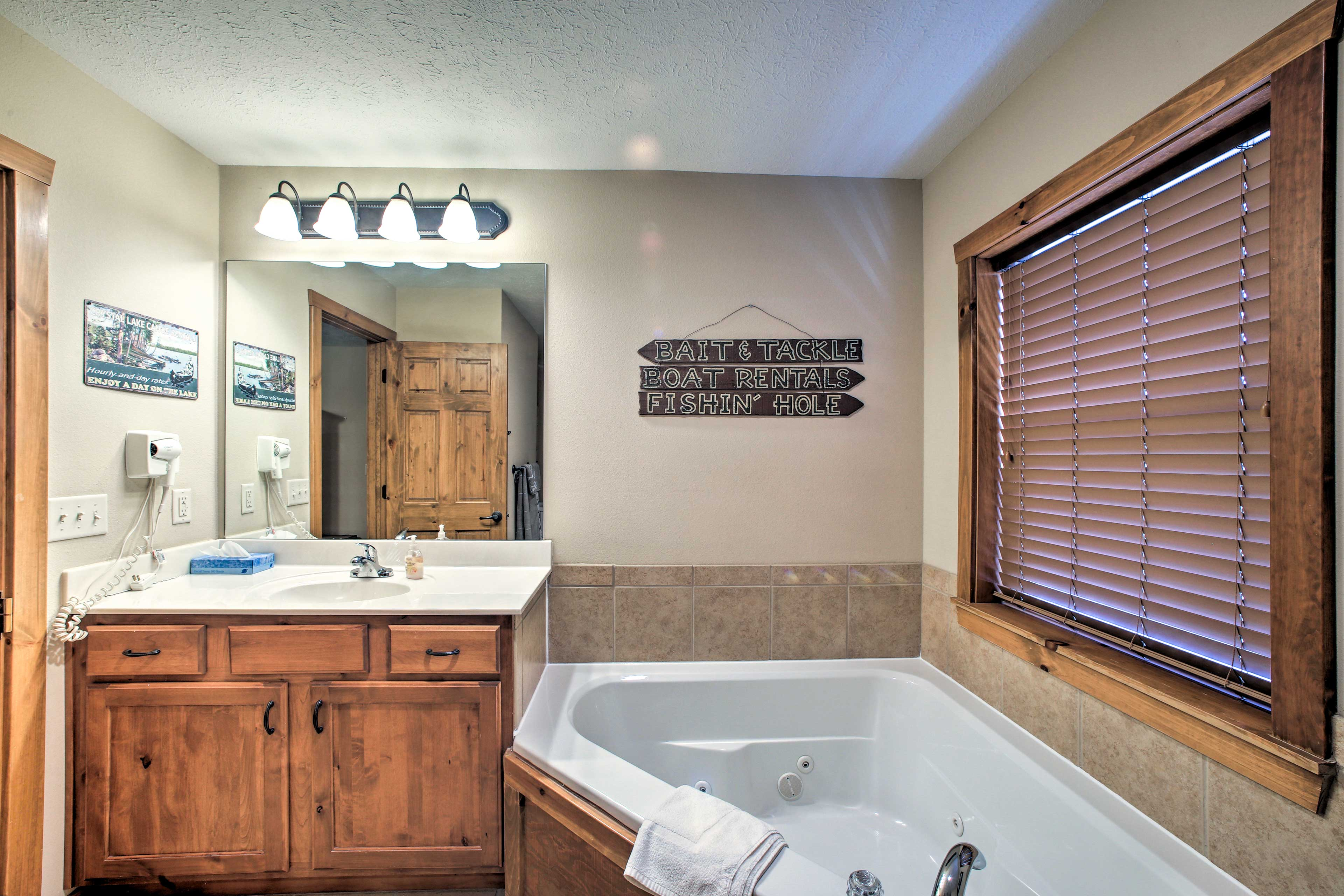 The master bathroom includes a jetted tub for ultimate relaxation.
