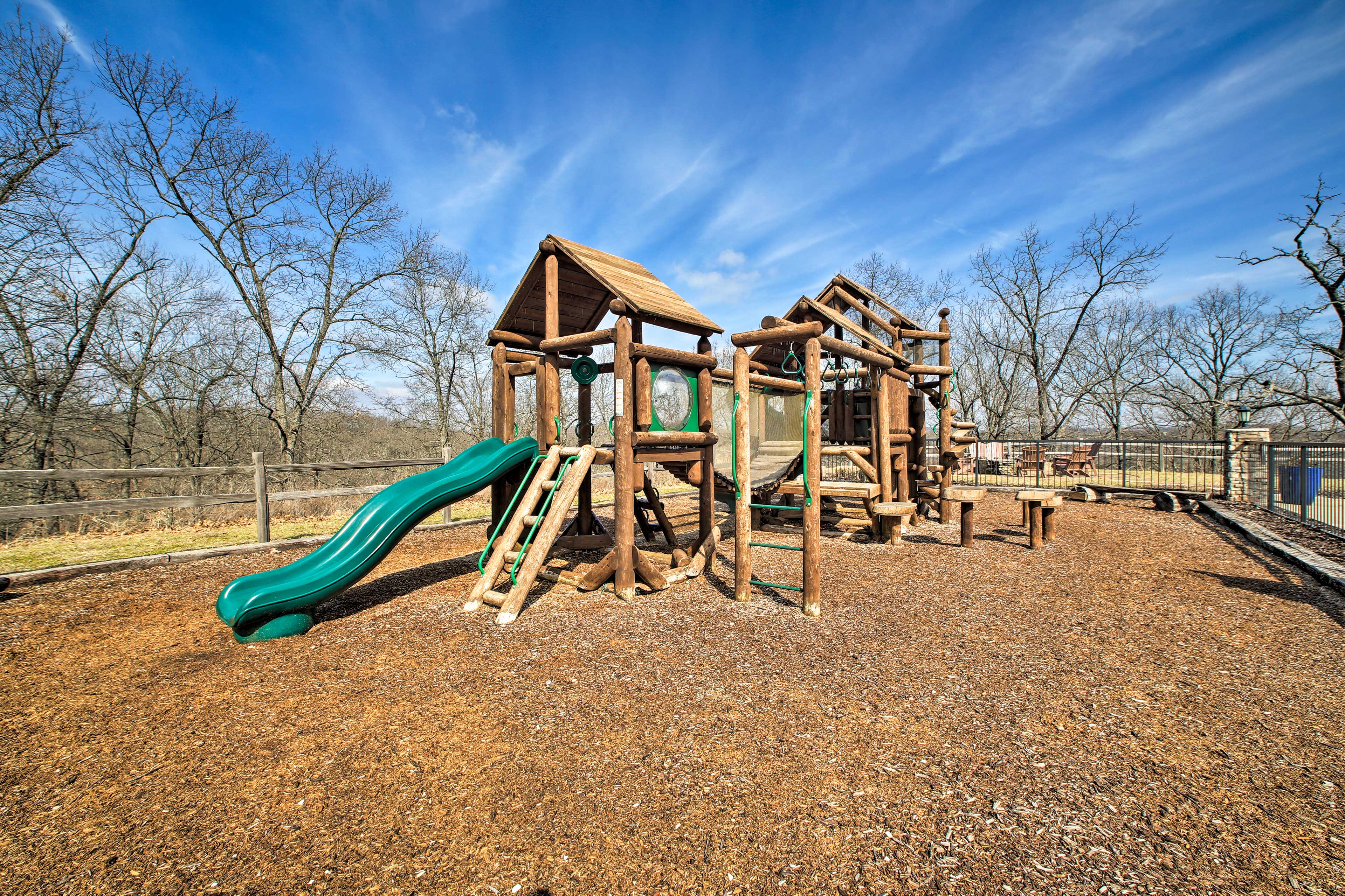 Kids will love clambering the rustic-styled playground right near the cabin.