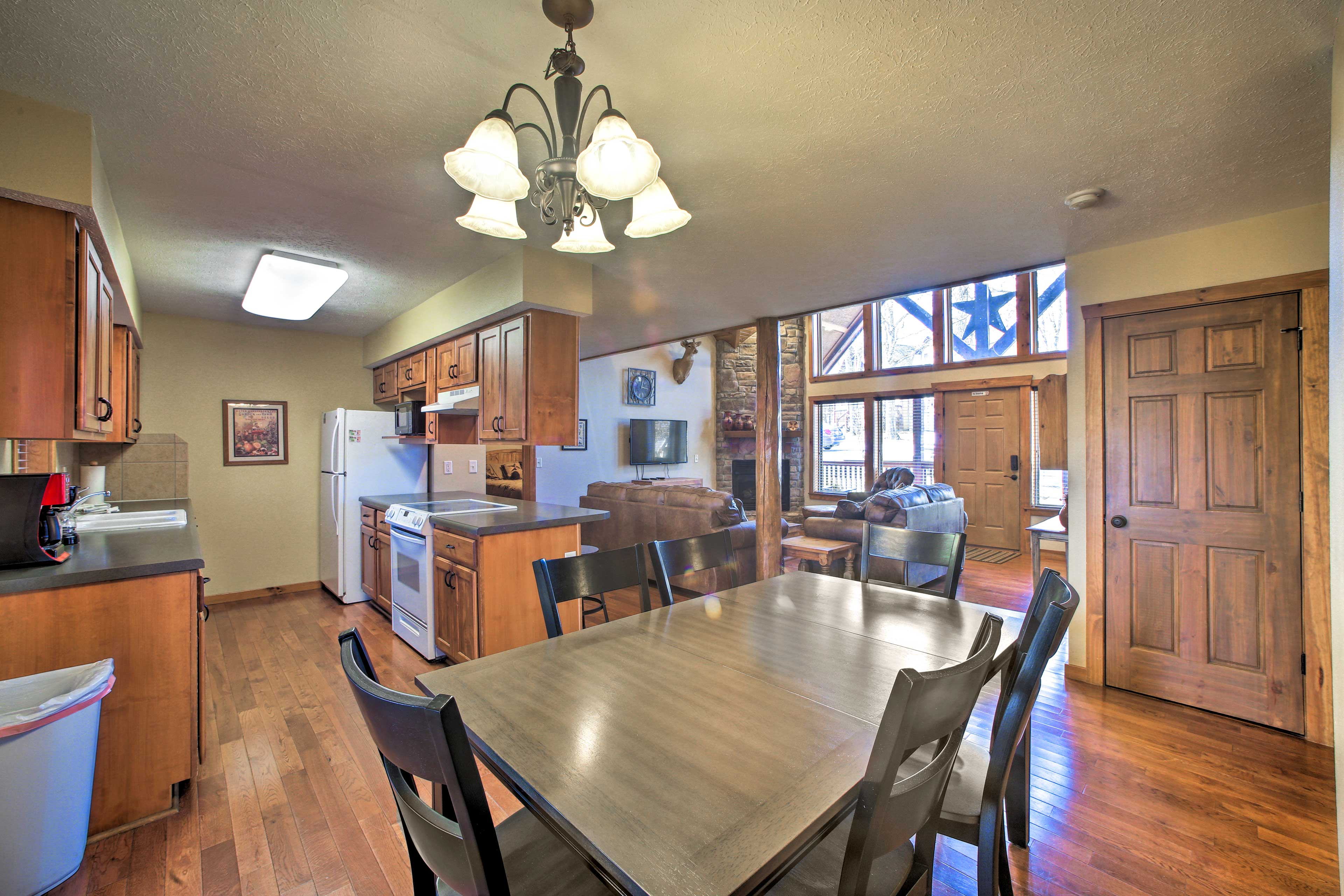 Gather around the 6-seat dining table for a home-cooked family meal.