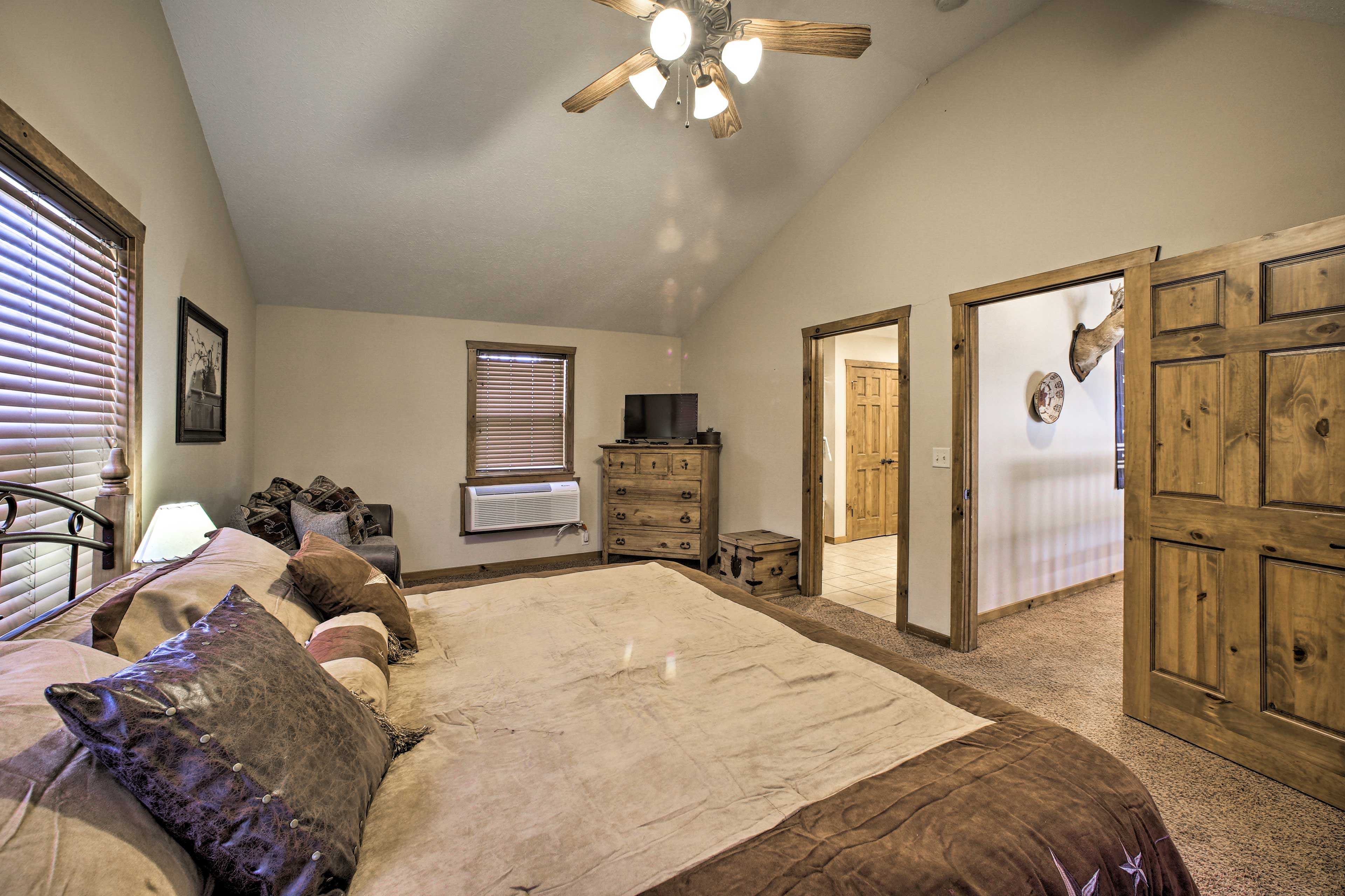 The 3rd bedroom includes a king bed, full-sized sleeper sofa, & flat-screen TV.