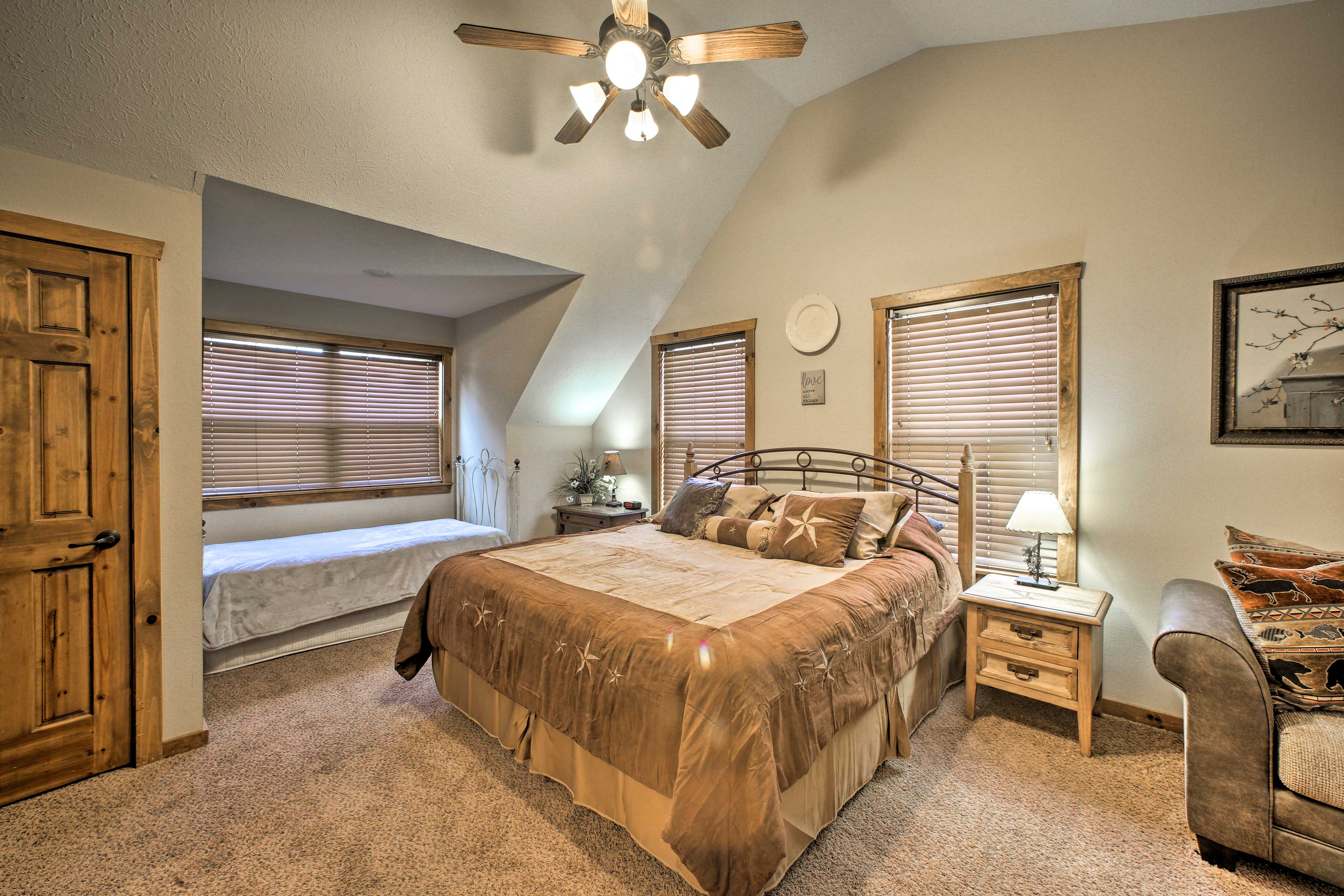 A twin-sized bed provides additional sleeping in this cozy 3rd bedroom.