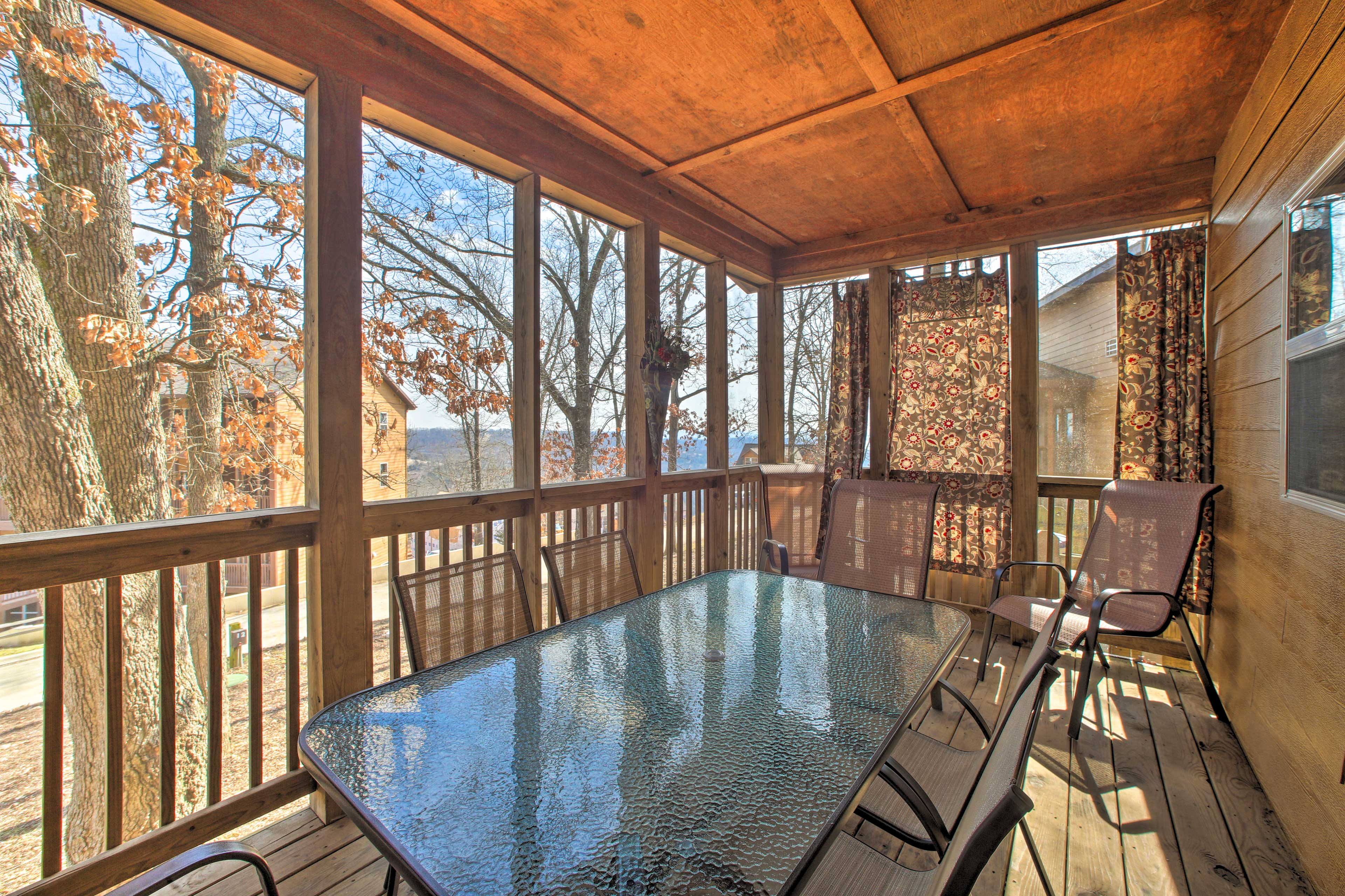 Highlights of the home include a screened deck, fire pit, grill, & more!