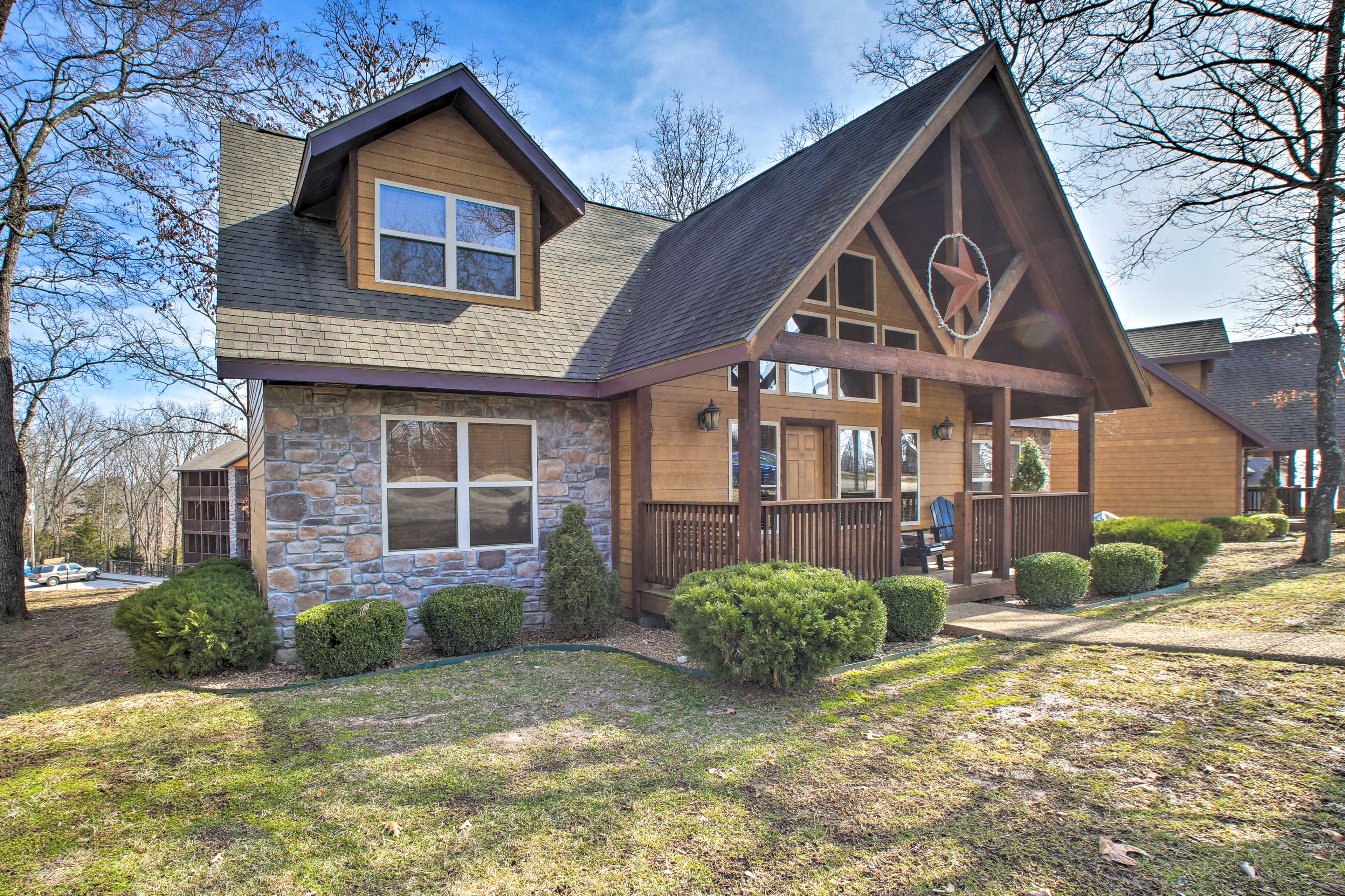 Embark on an epic group getaway to this 4-bedroom, 4-bath Branson cabin!