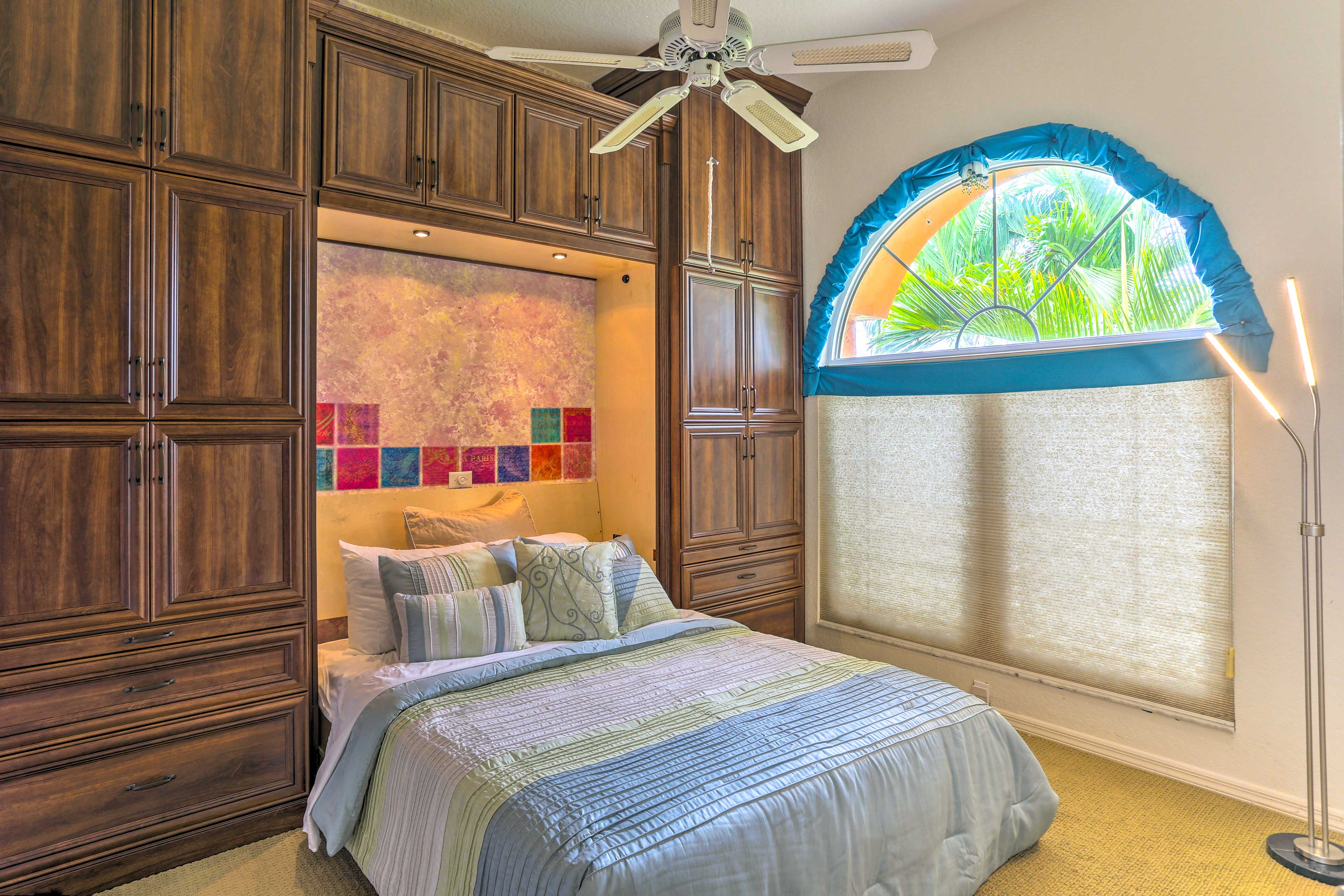 This bedroom offers you a queen-sized bed with custom built-ins cabinets.