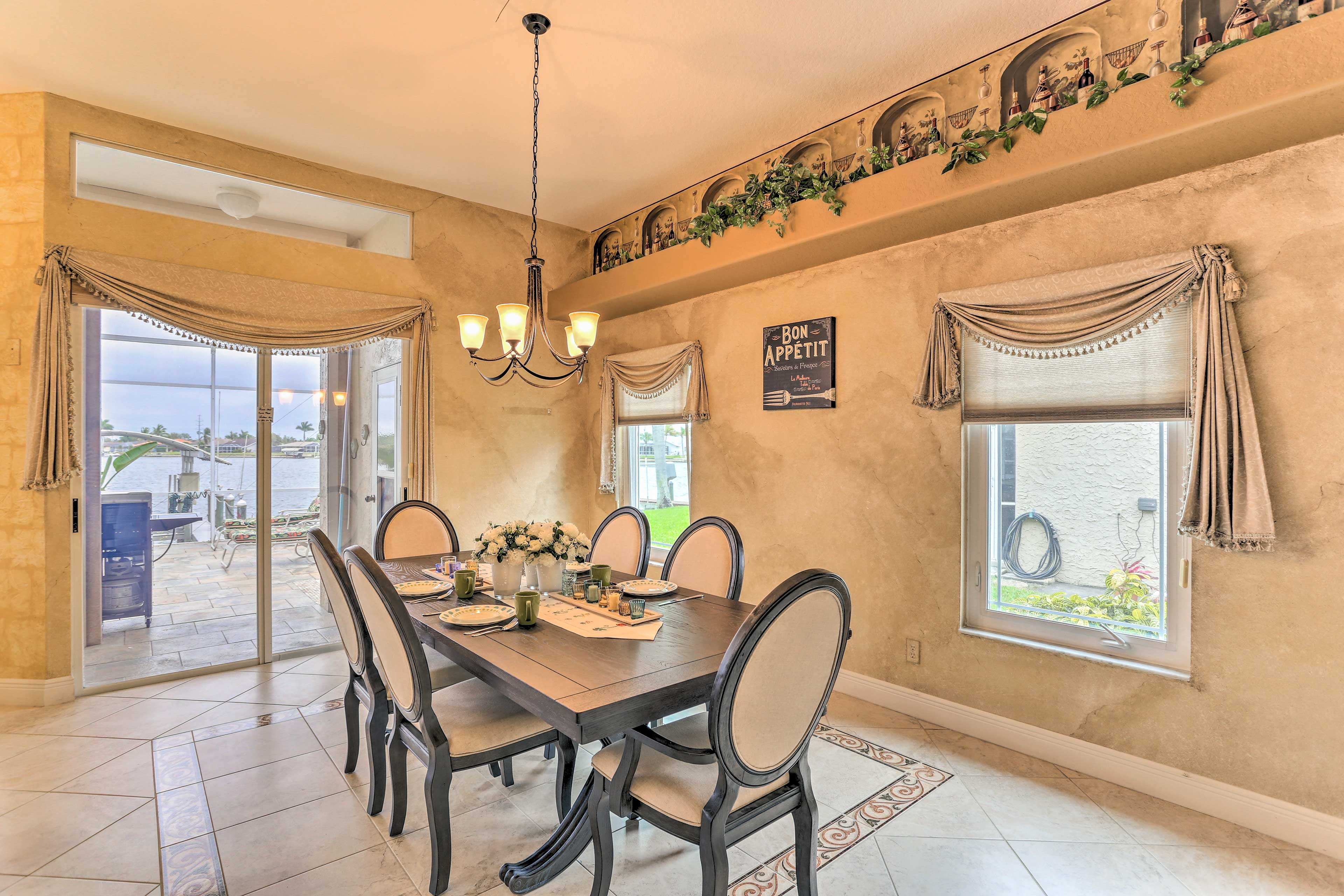 The formal dining room offers seating for 8 guests.