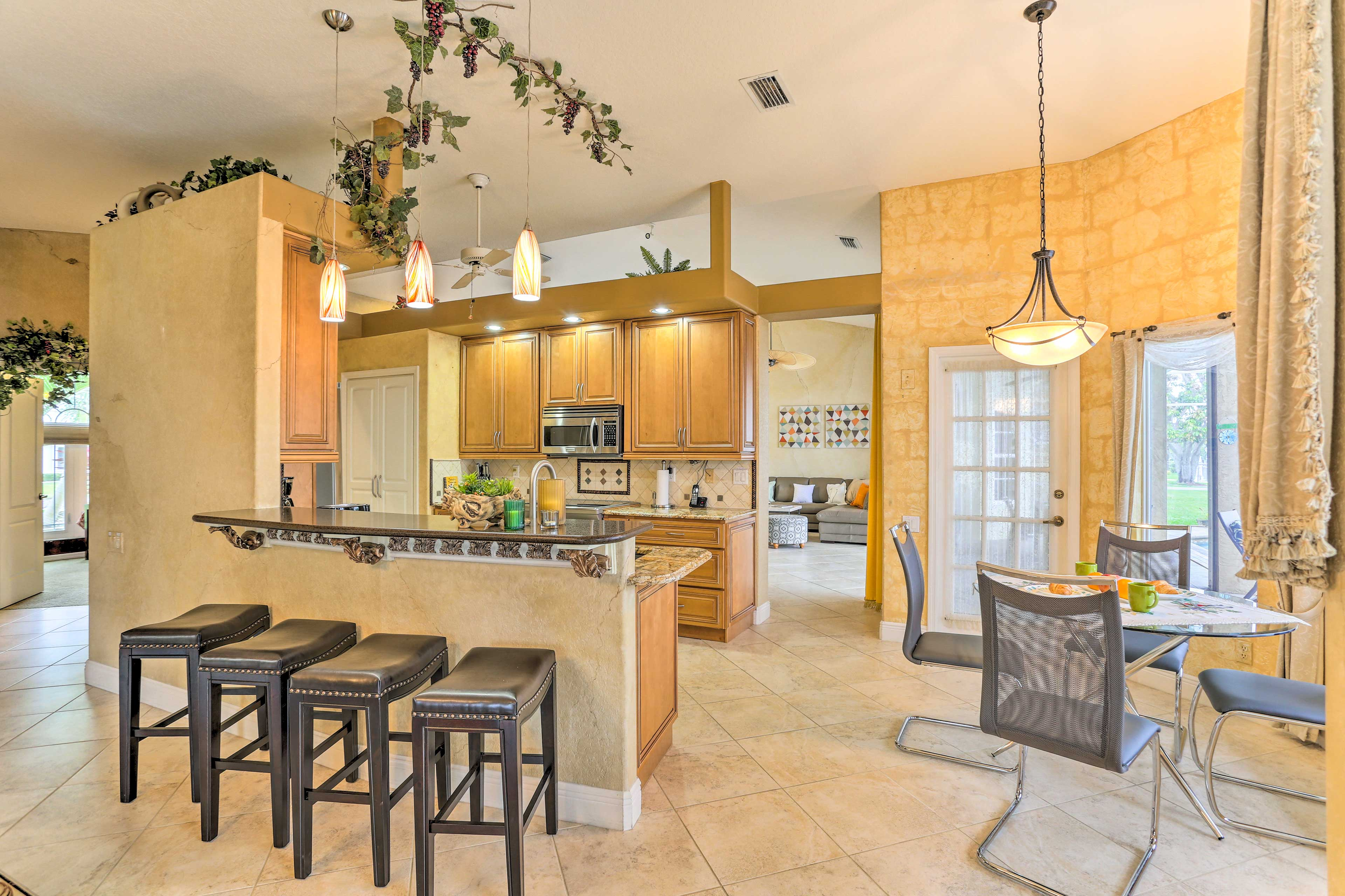 Discuss plans over coffee at the breakfast bar in this updated kitchen.