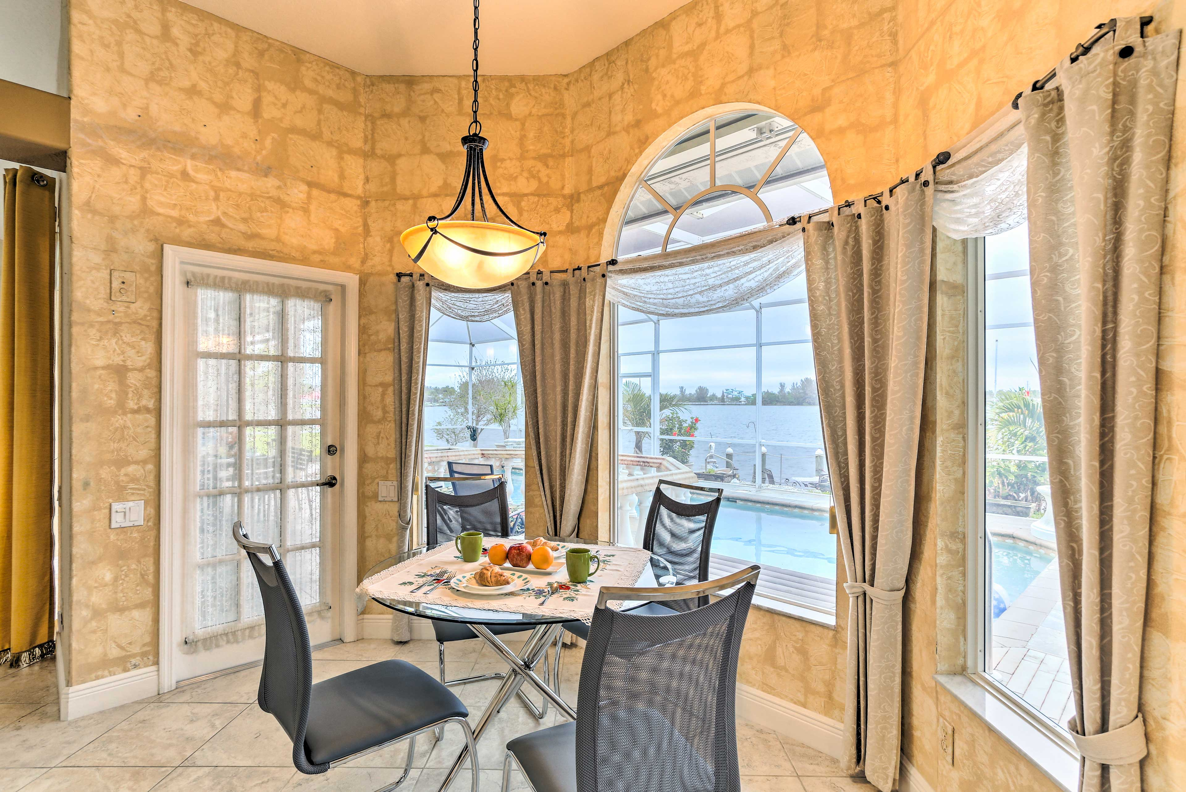 You won't miss out on the view, even from inside this 3-bedroom Cape Coral home.