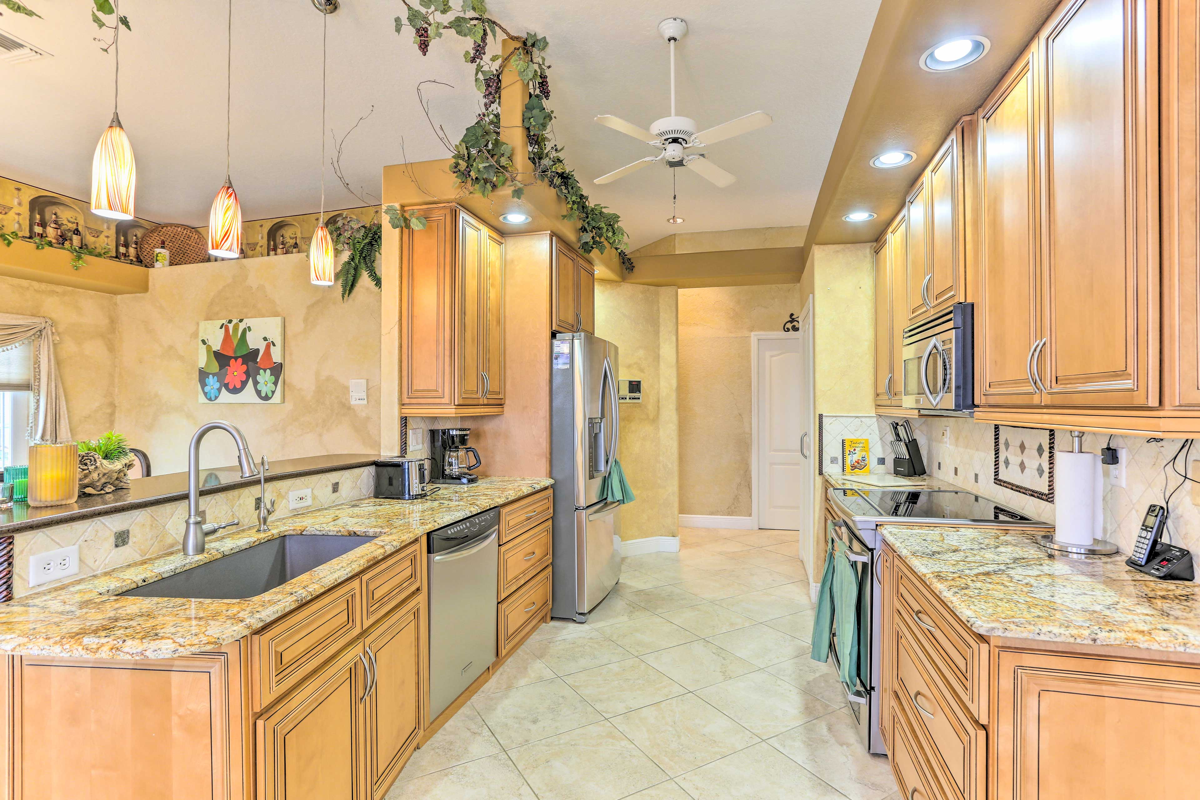 The granite countertops and stainless steel appliances highlight the space.