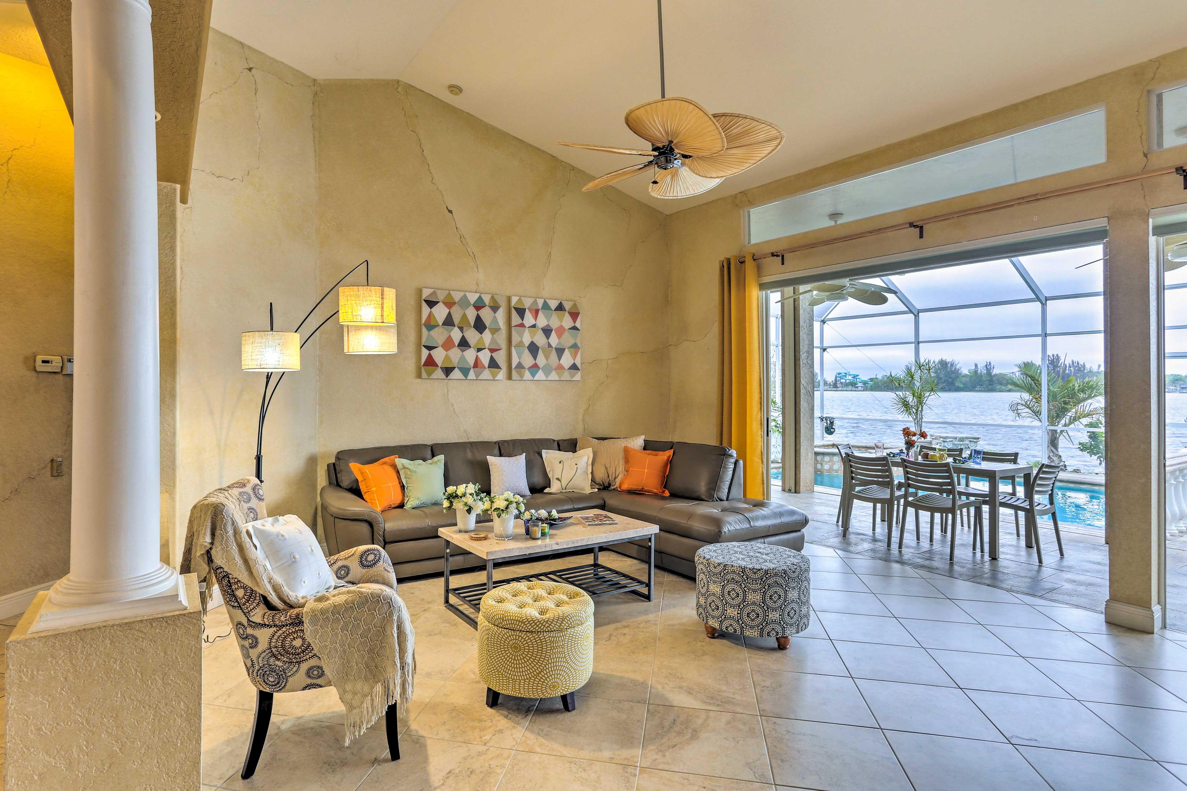 The living room features garage-style doors to create an indoor/outdoor feel!